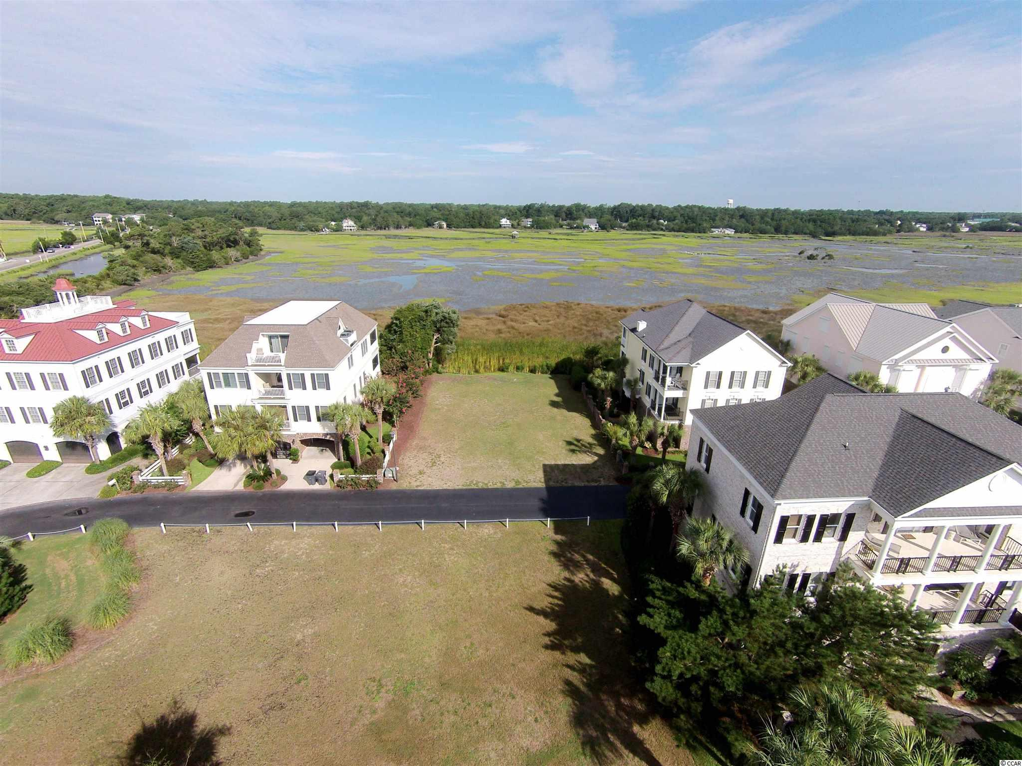 """Charlestowne Grant has been described as """"Charleston on the beach"""" featuring elegant low country beach homes in the finest of settings, nestled between the ocean and the marsh at the south end of Litchfield by the Sea. Lot 43 is one of the last of the premiere lots overlooking the marsh and inlet creeks while only a short private walk to the beach. Enjoy all the amenities of Litchfield by the Sea including private pools, bike and walking trails, fishing and crabbing docks, tennis and much more including one of the best beaches in all of SC. Sea Oats Circle provides the perfect setting for building a permanent or vacation home; come enjoy the Pawleys lifestyle!"""