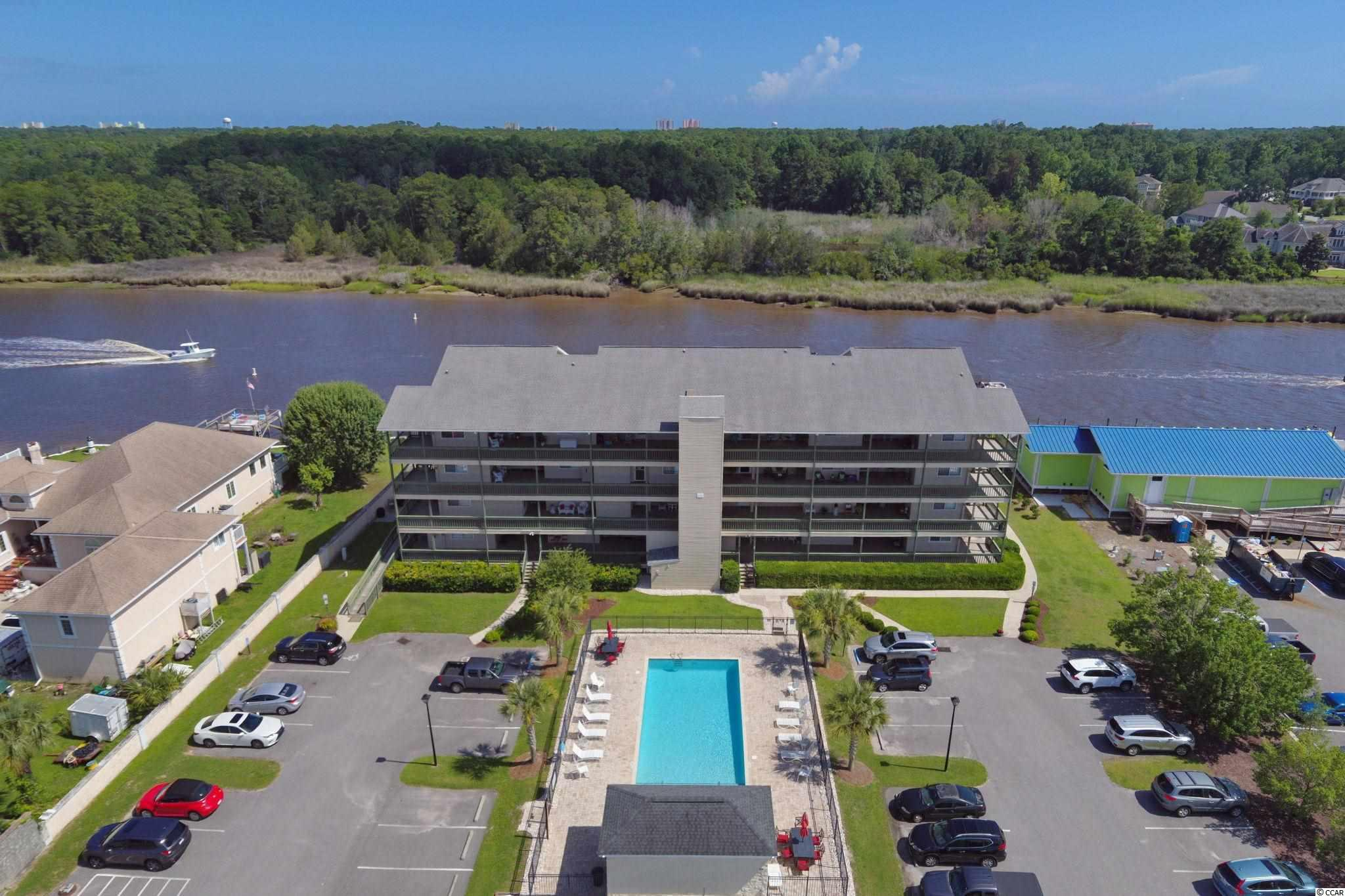 """** We are in multiple offer situation. Please present your highest and best offer by Saturday, July 3, at 1 pm** Direct waterway condo for this price??? WOW! Just take your seat on the porch, and never get up!  So close to the water, you'll feel like jumping onto one of the many boats and jet skis driving by! Completely remodeled in the style you will love, every detail has been done to perfection! Smooth ceilings, new kitchen cabinets, ALL new doors, including sliding glass doors in living room, new pipes in kitchen and hall bathroom.  2 bedrooms, 2 full baths, with tiled showers, gorgeous vintage laminate flooring, stainless steel appliances, white quartz countertops, accented backsplash, custom crown molding and judges panels in hall and bath enhance the beauty of this immaculate unit. Plantation shutters and window treatments convey and add that classic appeal to this condo.  So many features, you just have to see to appreciate!  Hidden away from the main streets, Kingsport condos offer a pool, elevators, a quiet building, but most of all, views for days of the waterway. Located in Little River, close to the Little River Waterfront, with gambling boats, restaurants, boat charters, and many shops to while away your time spent here. Either 2nd home of permanent residence, you will not tire of """"boat-watching"""" in this tranquil spot! Marina/boat storage/jet ski rental is next door for your convenience. Rarely does a unit come available in the building, so don't delay, as, you know, in this crazy market, it will be gone! Call now for your appointment to see this one!  Square footage is estimated and buyers are responsible for verification."""