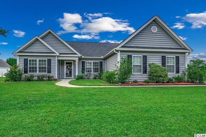 """This lovely 3BD/2BA ranch in Sedgefield just outside the city limits of Conway was built in 2017 with an open floor plan that's sure to please.  Spacious great room with ceiling fan, can lights, and sliding door to the backyard patio.  Kitchen features white custom cabinets, stainless appliances to include range, dishwasher and microwave. Dining area has drop down accent ceiling feature. LVP flooring throughout except carpet in one guest bedroom. Master bedroom has walk-in closets with ensuite bathroom offering a walk-in shower. Two guest bedrooms and bath on the opposite side of the house. Side-load garage allows for expanded driveway with ample parking. Additional features include cased windows throughout, storm door, 5"""" baseboards, gutters, and neighborhood sidewalks. Current monthly HOA includes trash removal, internet and basic cable."""