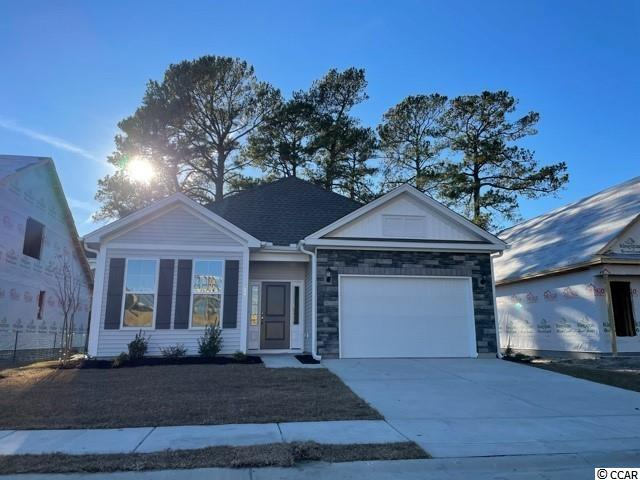 The Callaway is a one-story split floor plan with three bedrooms and two bathrooms. The kitchen has a large center island and it overlooks an open family room and eat-in area with access to the patio. The primary suite overlooks the backyard and features a spacious walk-in closet. Options include a covered back porch and fireplace in the family room. *NOTE PHOTOS ARE OF SAME CALLAWAY FLOOR PLAN AND ELEVATION FOR REPRESENTATION PURPOSES. THIS HOME WILL HAVE DIFFERENT FEATURES/COLORS - PHOTOS ARE JUST TO SHOW FINISHED PRODUCT AND LAYOUT WHILE HOME IS UNDER CONSTRUCTION CURRENTLY.   THESE PHOTOS ARE FOR REPRESENTATION PURPOSES 'ONLY' - REFER TO FLOOR PLAN AND ARTIST RENDERING INCLUDED IN PHOTOS.  THIS HOME IS BEING BUILT WITH VAULT CEILING IN MASTER BEDROOM & FAMILY ROOM, COVERED REAR SCREENED PORCH, MASTER BATHROOM WITH DOUBLE SINKS, 5' SHOWER STALL WITH TILED WALLS, IRRIGATION FOR LAWN, ADDED REAR GAS LINE, SINGLE KITCHEN SINK, GE GAS RANGE, CABINET LEVEL 300 IN KITCHEN WITH GRANITE COUNTERS, TILE BACKSPLASH ON ONE WALL, LVP FLOORING IN LIVING AREAS AND CARPET IN BEDROOMS, ADDITIONAL CONCRETE GRILL PAD IN REAR OF HOME TOO FOR BBQ AREA, 1.5 CAR GARAGE, GLACIER WHITE/PLATINUM GRAY/TUXEDO GRAY & DRYSTACK STONE EXTERIOR COLORS, FLAT PANEL WHITE CABINETS IN KITCHEN & BATHROOMS, RAISED VANITIES, LUNA PEARL GRANITE IN KITCHEN & BATHROOM SINKS, WHITE TILE KITCHEN BACKSPLASH, , GRAY CHESTNUT LVP FLOORING, PERFECT TAUPE CARPET IN BEDROOMS, CERAMIC TILE IN MASTER BATH FLOORING.