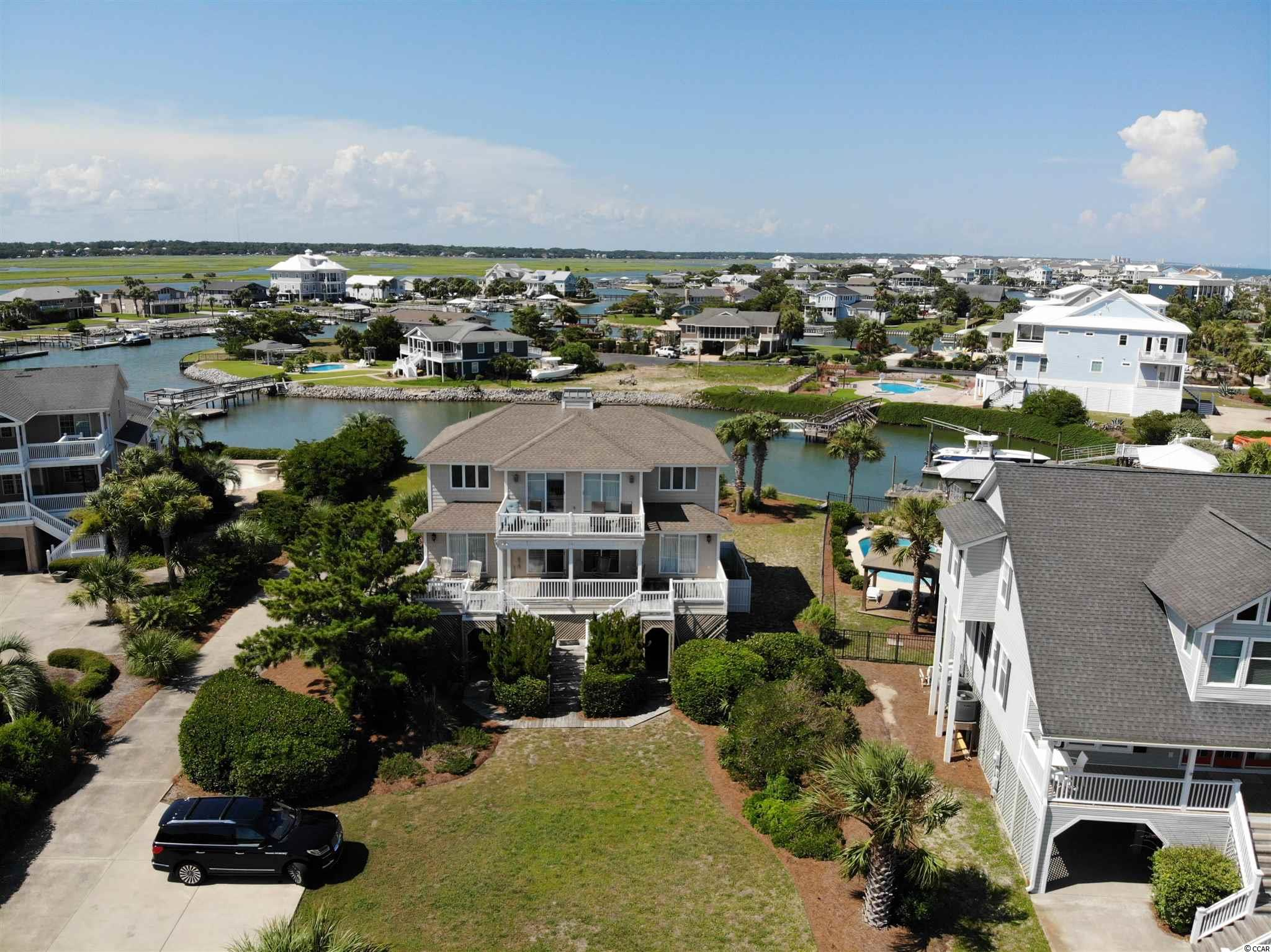 """""""Sand By Me"""" is a 5BR/4.5BA home located in the very southern gated community of Garden City Beach known as Inlet Harbour.  This particular beach home overlooks an undeveloped oceanfront portion of Inlet Harbour and out to the Murrells Inlet Jetties.  It features a private heated pool, private boat dock, covered outdoor kitchen & bar, two separate living areas and expansive views of the ocean and inlet from the two second floor balconies.  Given the location and amenities, this home has a great rental history.  Contact the listing agent, or your Realtor, for more information or to set up a private showing.  Please check out the Matterport 3-D Virtual Tour! https://my.matterport.com/show/?m=MZguGCQkz4Y&mls=1"""