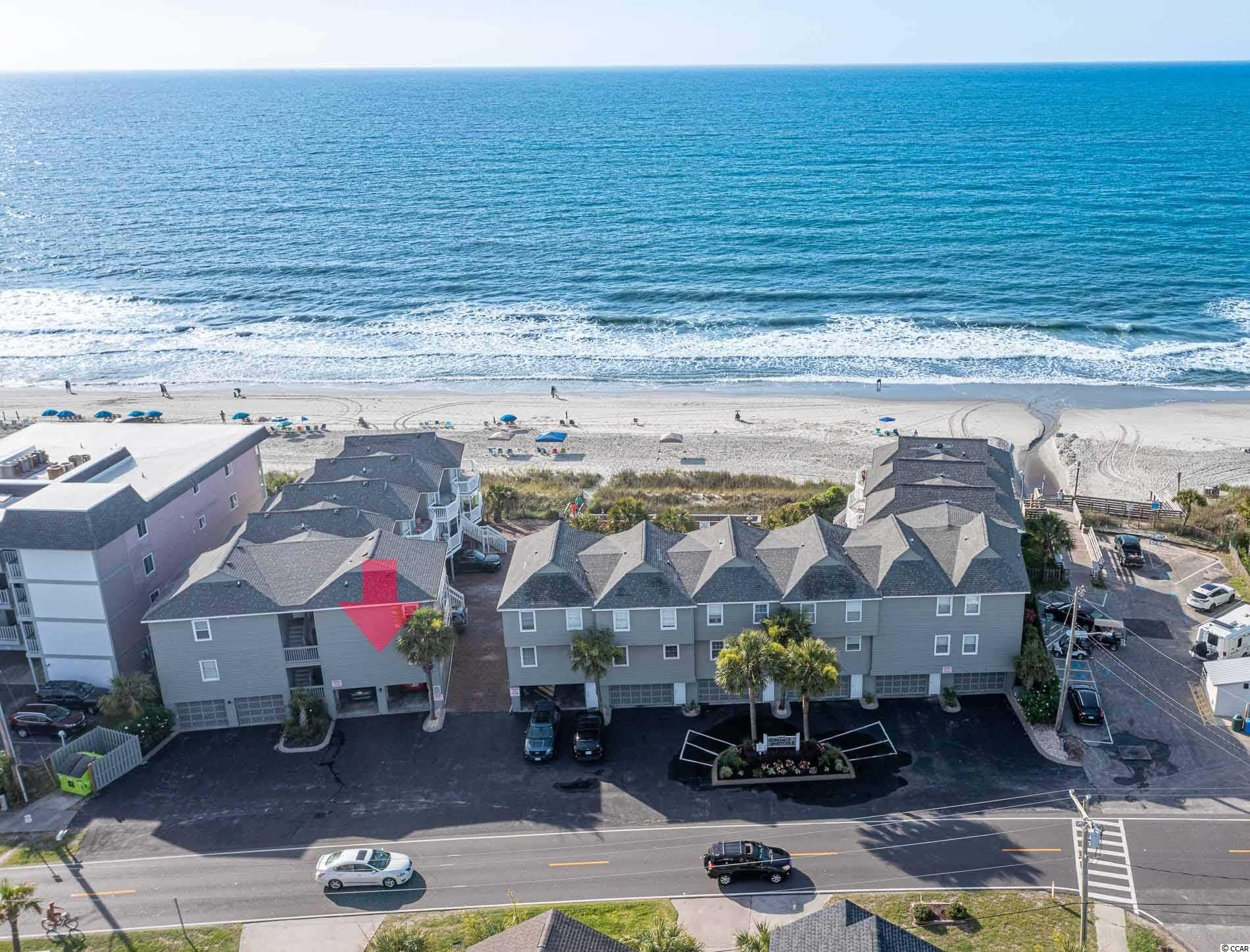 """You've Been Waiting....And It Is Finally Here...Your ONLY CHANCE To Own A Condo On The Ocean In Surfside Beach Today!  This 3 Bedroom, 2.5 Bath Corner Unit Is 1300+ S/F & Features Ocean Views And The Rare Amenity of A PRIVATE TWO CAR GARAGE.  The Ability To Store A Golf Cart or Motorcycle On The Oceanfront Is EXTREMELY RARE.  There Are Also Multiple Storage Closets/Areas On Ground Level.  Admiral's Quarters II Is A Great Complex in Popular Surfside Beach - the """"Family Beach"""" - Which Boasts A Large Pool Area, & HOA Fee That Covers The Typical Amenities/Utilities, Except Unit Electric & HO-6 Insurance.  Sold Furnished.  Updates Include Quartz Countertops, All Solid Flooring, Remodeled Baths.  This Well Maintained Condo Is Also A Turn-Key Rental Property...Use It Some & Have The Renters Pay For Your Beach Getaway!  The Town of Surfside Beach Offers Tons of Benefits Including Its Own Police, Fire, Storm Water Maintenance, Street Cleaning, Debris Removal, Trash/Recycling, Community Events Like Farmer's Market, Parades, Festivals, Luaus & More. Measurements & Sq. Footage Approximate."""