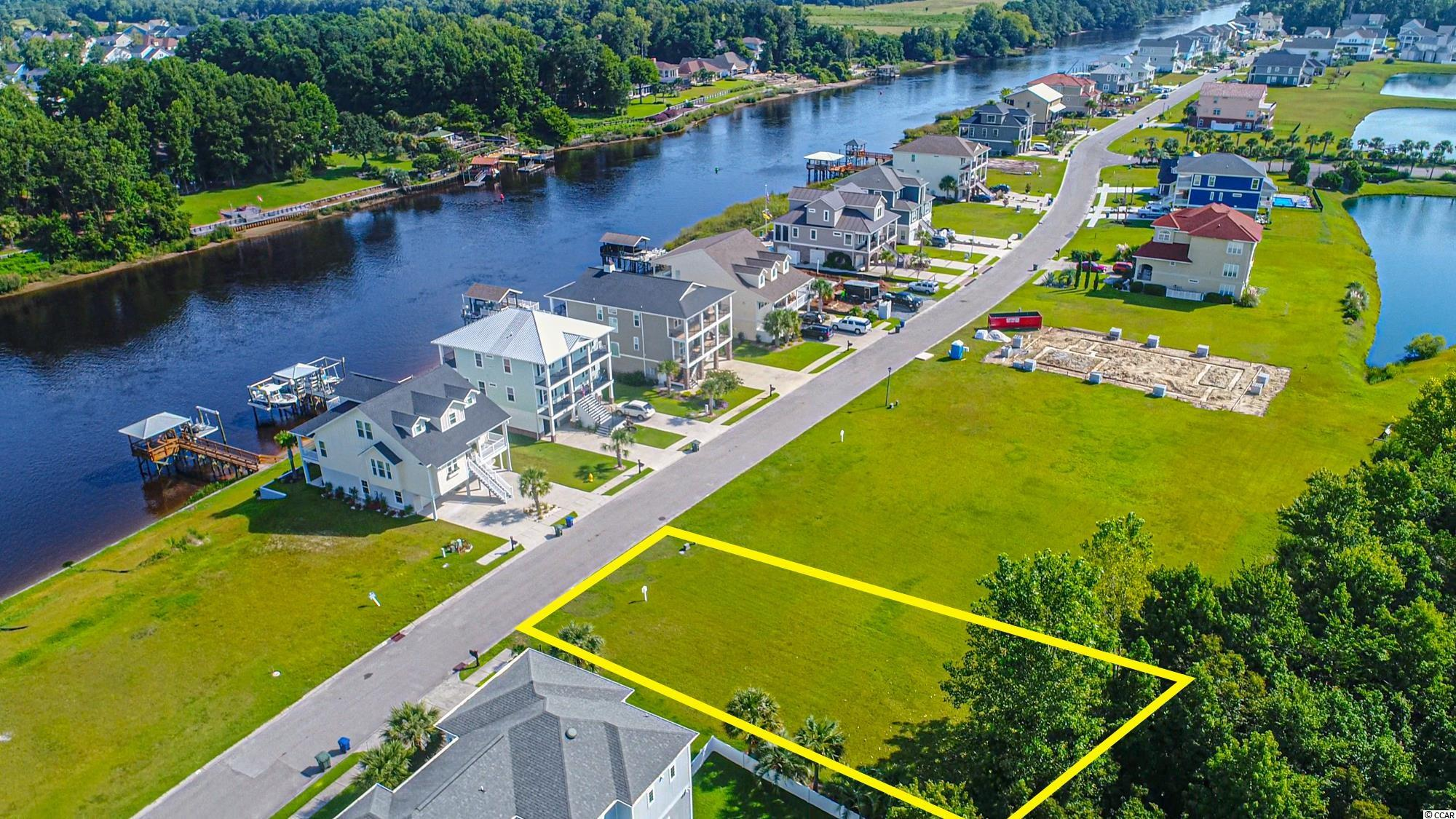 Great looking intracoastal waterway views from this second row lot in Palmetto Harbour. Upscale smaller community in North Myrtle Beach, located beach side(east) of the waterway for easy and quick access to the beach, Main Street and everything North Myrtle has to offer. NO timeframe to build, so buy now and build now or anytime in the future. Lot 74 is situated near the end of a cul de sac for a quiet feel.