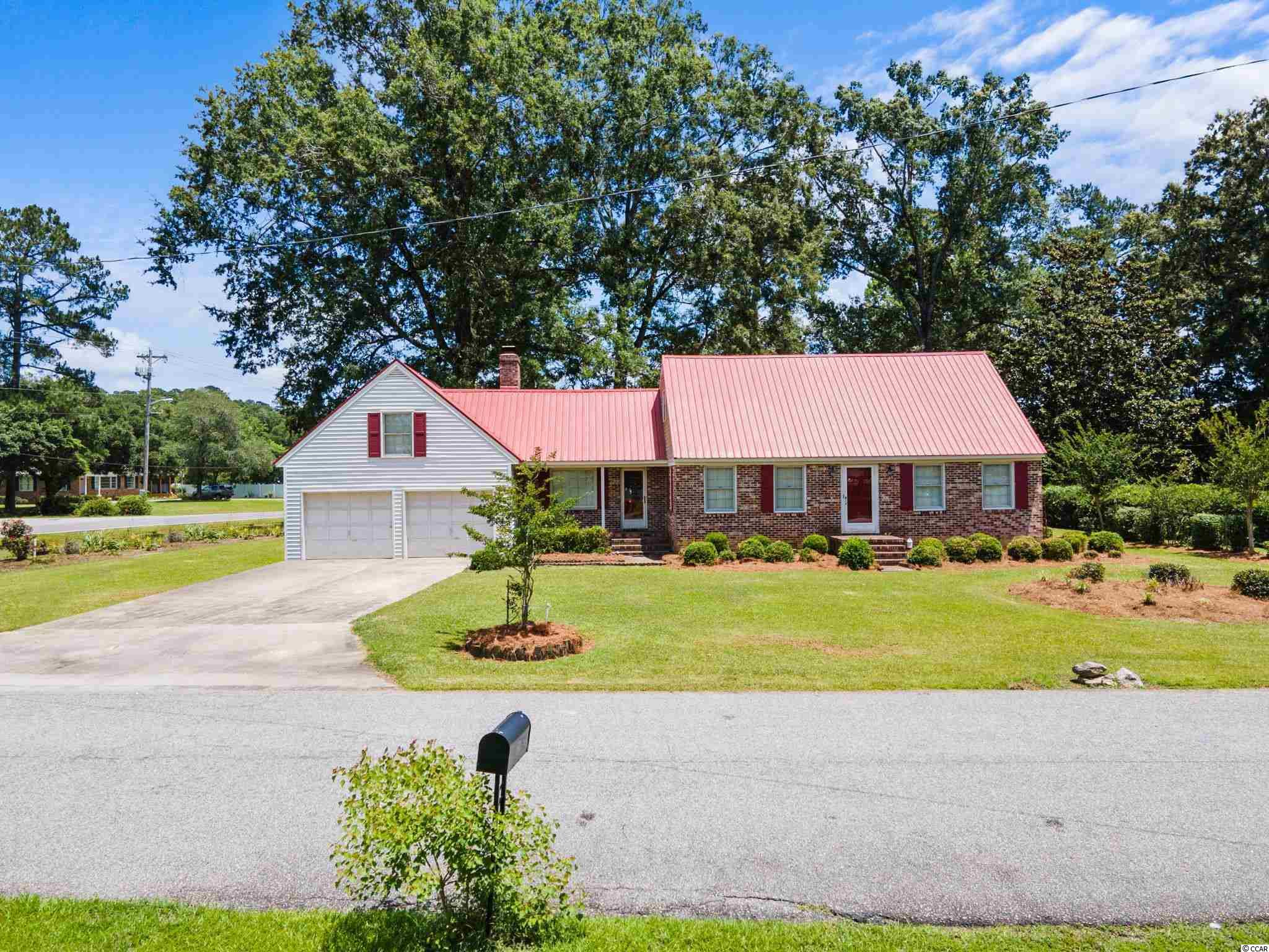 Located just minutes from historic downtown Conway, this brick 4 bedroom/2 bath home sits on a beautiful corner lot on over a half acre in the well-established Conway Country Club area.  This home has lots of space to spread out with family and friends to enjoy a large backyard with mature trees and garden beds throughout.  Inside you will find a brick fireplace that sits at the helm of the family room that adds a perfect touch of character.  The home offers a formal dining area, two bedrooms downstairs with a full bath and two oversized bedrooms upstairs with another full bath.  There are several easily accessible storage areas throughout the upstairs with a large walk in attic space.  A large bonus room over the garage includes built in bookshelves and makes a perfect space for a media room or additional living space. A unique floor plan can be accommodating to any size family.   The land surrounding this home offers a rare opportunity and space for gardening and outdoor entertainment.  The home has a metal roof that was installed in 2016 as well as a brand-new upstairs HVAC unit with warranty installed in June of 2021.  This home is being sold AS IS and is not located in a flood plain and doesn't have an HOA!