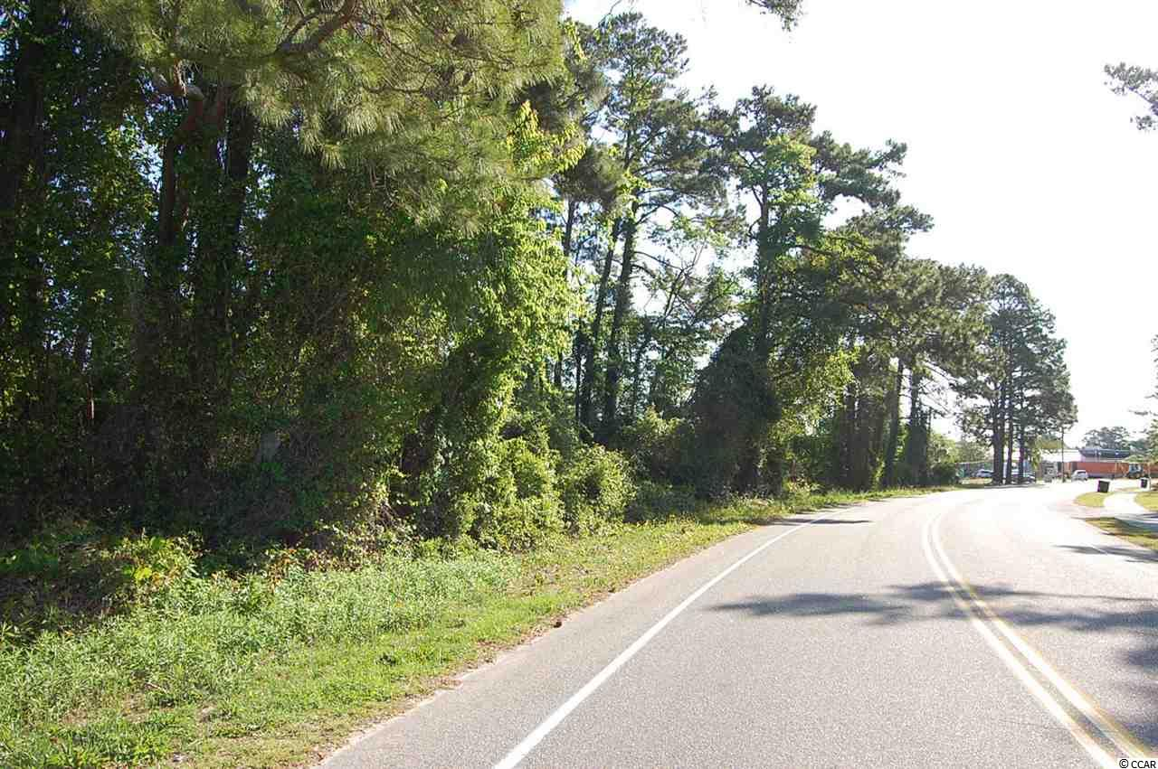 Location, Location! Commercial lot located just one block off Main St. and easy access to the waterway bridge connector to Hwy 31 in the heart of North Myrtle Beach in the Ocean Drive section and directly behind Family Dollar.  Property is approx 0.60 acres and is zoned HC by the City of NMB.  This is a prime location behind/beside McDonald's restaurant directly behind Family Dollar store and across from Synovus Bank.  This zoning allows for a vast array of commercial uses.  Road frontage is approx. 218 ft.  Total dimensions as per CRS data are 218' x 98' x 187' x 203'.