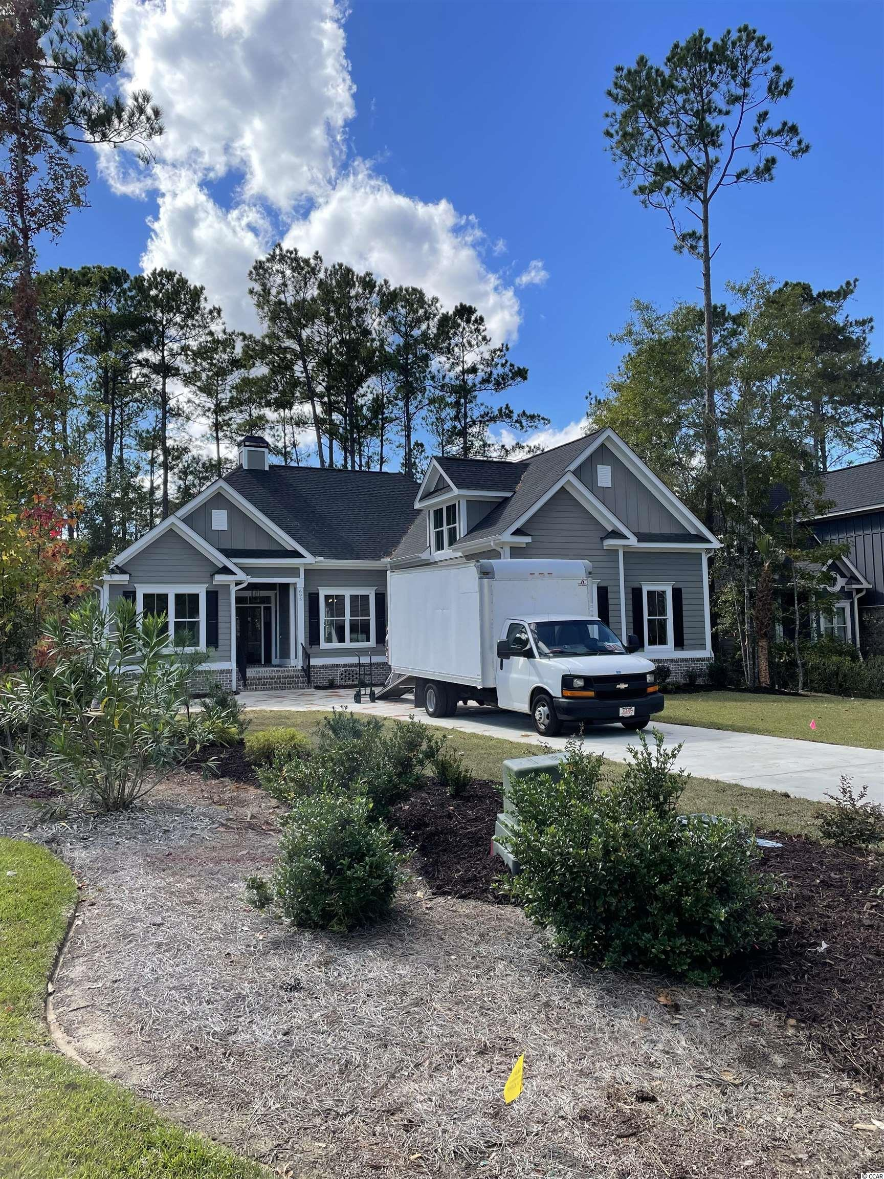 New home under construction in desirable gated community in Murrells Inlet. Close to beaches and excellent dining. Still time to make many of your own selections. Projected completion September.