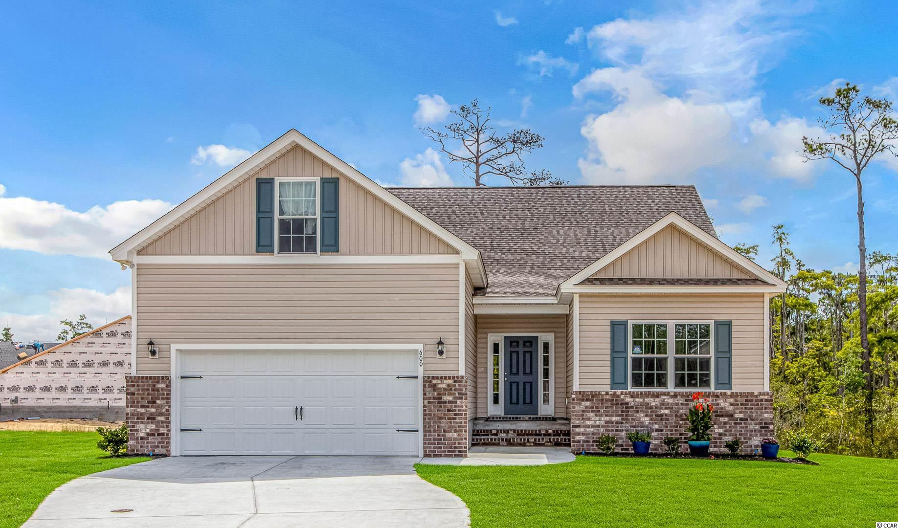 This 4 bedroom, 3 bathroom home is available in the Winyah Bay community in Georgetown. You can move into this like new home, constructed in 2021 without waiting for the building time! This home shows like a model and features LVP flooring throughout with carpet in the bedrooms. A desired open floor plan is present with plenty of windows allowing natural light to pour into the home as well as vaulted ceilings providing a spacious feel. The kitchen is immaculate, with white staggered, soft close cabinets with crown, granite counters, a work island with breakfast bar, tiled backsplash, stainless appliances and pantry. A laundry room and generous sized closed providing an abundance of storage sit off of the kitchen. A split bedroom plan is present in this home. The master suite has elegant tray ceilings, a double vanity and oversized shower. Two guest bedrooms are on the main level and upstairs you will find another bedroom which includes a walk-in closet and full bathroom. This water-oriented community just off of Winyah Bay has a community clubhouse with boat dock and ramps, as well as boat and RV parking. Measurements are not guaranteed and are the buyer's responsibility to verify.