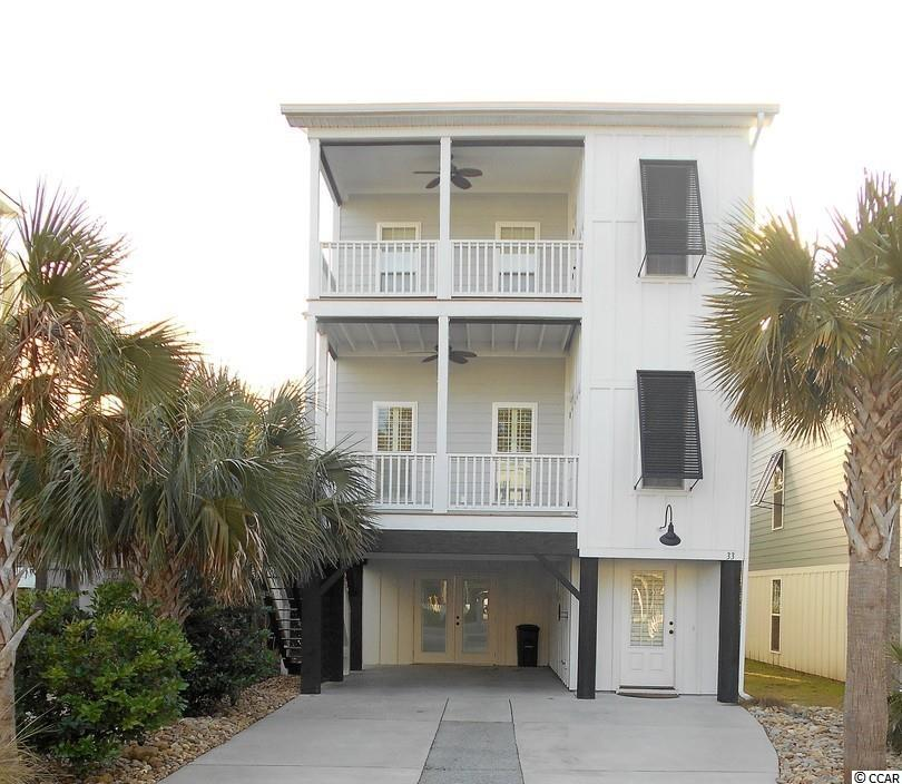 Stunning 3 bedroom, 3.5 bath home in Murrells Inlet located at the beginning of the bike path to Huntington State Park with a 2 minute drive from front door to Huntington Beaches. Input your kayak or canoe across the street and be close enough to local Marsh Walk festivities, upgrades includes private 3rd floor master suite with balcony and a view of the Marsh, luxurious master bath with extra large tile shower stall and extra large garden tub with whirlpool. Private guest bedrooms on the main floor plus a bedroom on the ground floor with a private bath for extra guest quarters. Reclaimed heart of pine flooring throughout. LVP flooring on the ground level. Patio in back w/ live vertical plant wall for privacy. Home includes a watering system installed to maintain foliage. HOA maintains the lawn.