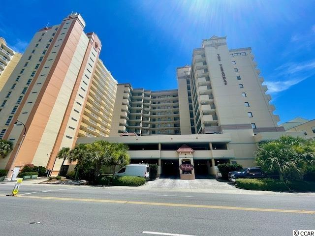 This is your chance to live on the beach in the desired Ocean Drive Section of North Myrtle Beach !!  This immaculate and move in ready, fully furnished one bedroom, one and a half bath condominium will not last long.   As you enter the unit, you are greeted by a sunshine filled living area with large and unobstructed pool amenities and beach views.  A sizable shaded balcony allows you to have your morning coffee watching the beach goers collect shells and frolic in the ocean waves.  Heading back inside, a pleasing palette of light colors and beachy themed décor will delight the new owners.  Kitchen is equipped with a large granite island, white cabinetry, brushed nickel hardware and stainless steel Frigidaire Gallery Collection appliances.  Moving into the hallway, there is an energy efficient stackable washer and dryer with a small storage area.  A larger attached storage unit is located right outside of the front entry way for all your beach gear.  Next you will see the guest half bath with granite vanity countertops and two linen closet cabinets to hold toiletries, bedding and towels.  There is a door which separates the guest bathroom and the master bathroom so you can keep your personal belongings separate from visiting guests (and you will be asked constantly to be a host in this condominium).  The final room is the large Master Bedroom with views of the blue sky through plantation shutters from your work desk and the Master Bath ensuite.  Bathroom comes with a tub/shower combination featuring a relaxing rainhead shower and plenty of cabinet space under your granite countertop vanity.  Ever desirable luxury vinyl flooring flows throughout the unit which is virtually waterproof and can handle pets, sand and water with ease. Outside your new home, you can venture out to the pool, hot tub or lazy river to spend your day in the salty ocean breeze and sunshine.  And of course, last but not least, the BEACH!  Did you see that view!?  Seagrass and sand dunes are ple