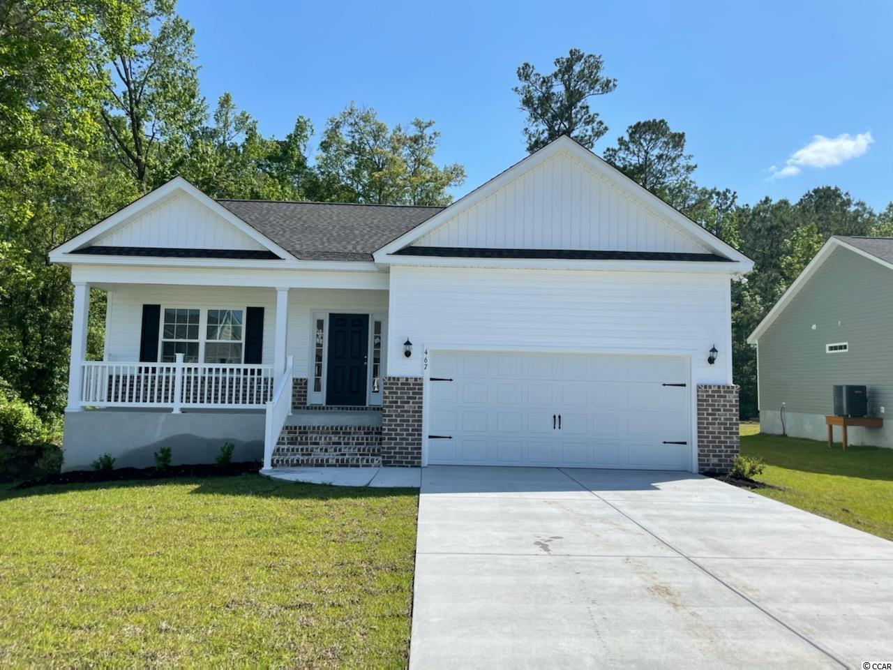 This Busbee Model has it all! 3 Bedroomw 2 Baths with and a 2 Car Garage. at 1416 Sq Ft.  This Open concept home with a modern design sits on a spacious lot. The floor plan features lots of windows and 9ft. ceilings With vaults allowing natural light to flow in. The living and dining rooms are adjacent to the large kitchen and breakfast barwhich makes entertaining easy and effortless. This Kitchen includes Granite Countertops, Benton White painted cabinets, and stainless appliances. Come see all the insightful features designed with you and your lifestyle in mind. Beautiful and durable Waterproof Laminate Flooring throughout the entire plan. Pictures are of a similar home and are for illustration purposes only.