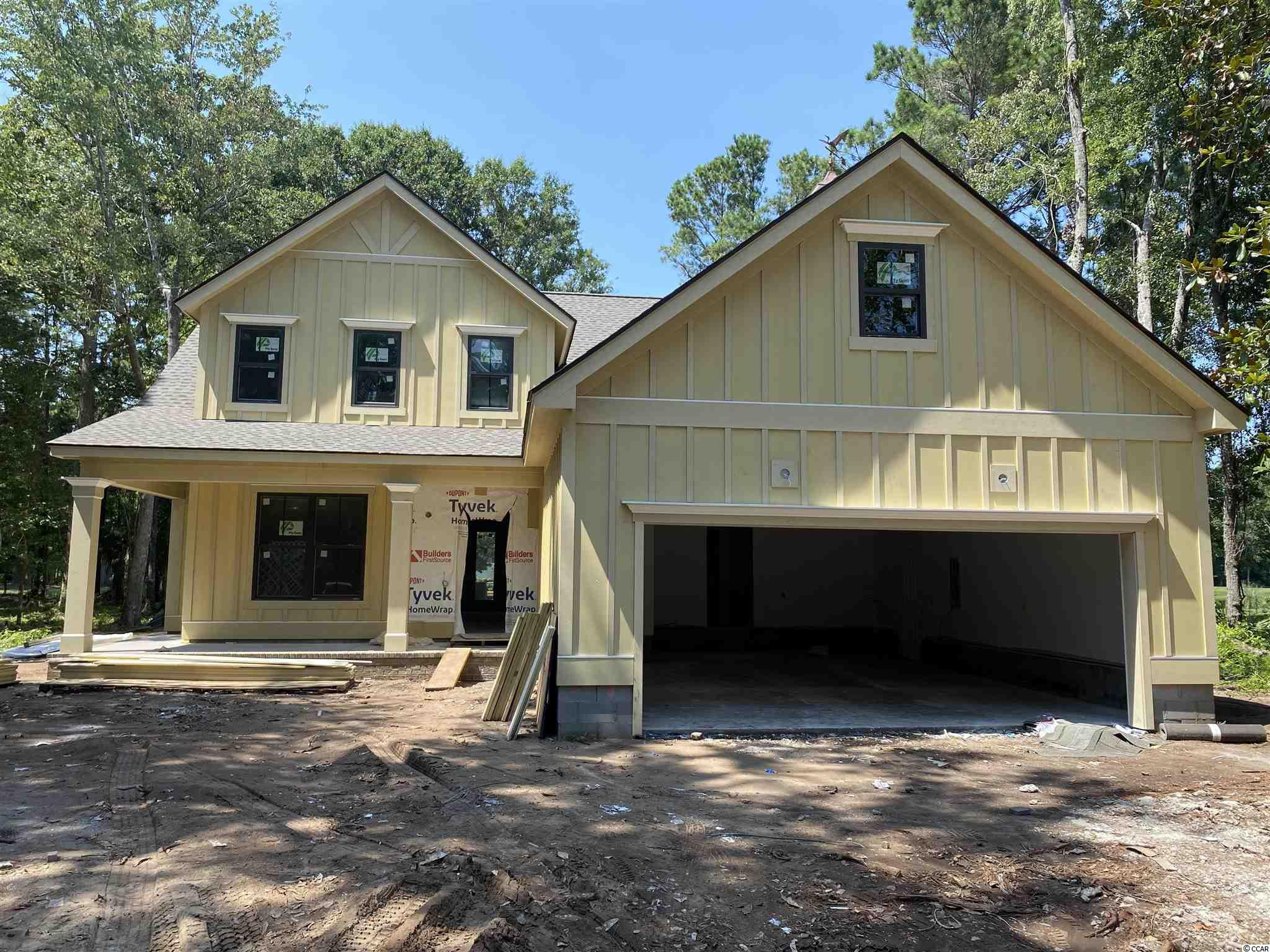 Think Southern Living...think Litchfield Plantation and this Low Country Home being built by the Southern Living Preferred Builder Member for the Grand Stand. This low country home is two story with the Owner's Suite on the First level AND a flex space that can be a second bedroom or office on the main level. Second floor has two spacious bedrooms with their own bathrooms and walk in closets! Open floorplan concept with a large covered porch that includes a gas fireplace! Great for entertaining or spending those Carolina nights on the porch for the big game! The Litchfield Plantation amenities include a beautiful swimming pool on the marsh, large club house, gated security and best of all its very own beach house on the island!!  Welcome home to Litchfield Plantation, Pawleys Island, SC! (Pictures are from previously built model.)