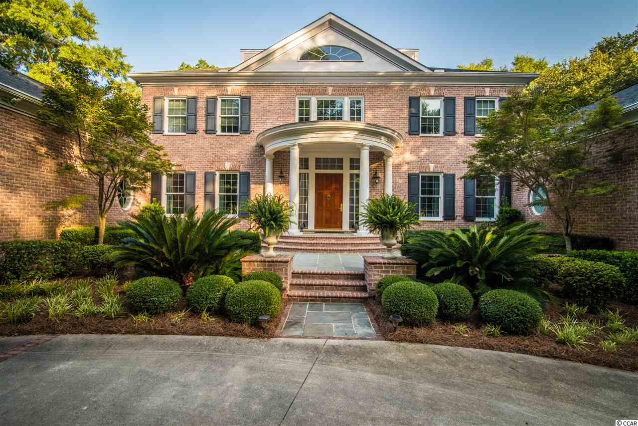 PRINCE GEORGE - ELEGANT SECLUSION from The River to The Ocean - A true classic brick Georgian residence, perfectly proportioned & designed to take advantage of the high bluff 1.89 acre site overlooking historic former Ricefields and the majestic Waccamaw River. Located on the Riverside of Prince George, a neighborhood of 1900 acres allowing only 150 homesites, stretching from the Atlantic Ocean to the Waccamaw River where residents enjoy both private beach and river access. A beautiful courtyard garden leads you to the formal portico. The Chicora Wood Plantation replica door opens to a two story grand foyer. To the left is the formal dining room and to the right is a formal living room with a fireplace. The central hallway leads you to an expansive great room where a wall of windows focuses your attention to views of the marsh and the river beyond. Other special features are a fireplace with bookcase surround. The huge gourmet kitchen, just to the left of the great room, also has a wall of windows with views of the formal garden and river sunsets. The kitchen features abundant custom cabinets, an over-sized island, granite counter tops and all stainless steel appliances, including a 6 burner Viking range, Viking double oven and warming drawer, Subzero side by side refrigerator, etc. A beautiful wet bar with glass front displays and a wine cooler sits between the kitchen and a beautiful morning room overlooking the garden. The kitchen is connected to the formal dining room by a small hallway where a large butlers pantry and serving counter are located. The master suite is located on the north end of the home with its own private porch, fireplace, his & hers walk-in closets and beautiful master bath. The 4 additional bedrooms are upstairs and share a large landing that overlooks the foyer. Bedrooms include private and shared baths, built in bookcases, walk-in closets and terrific views. A large upstairs porch overlooking the backyard is accessed through a cedar panele