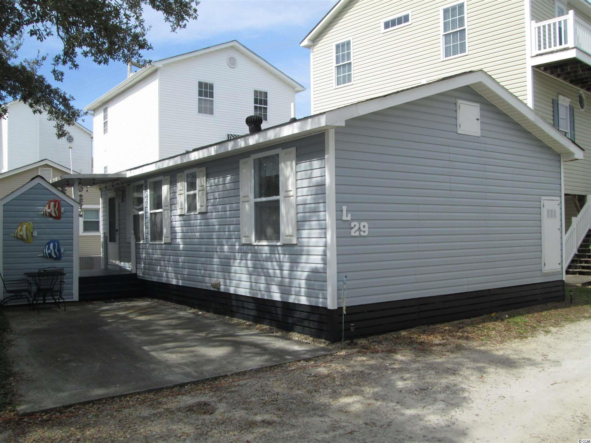 This Home is situated on a permanent site located off of a paved road. All sites are close to the beach and most of amenities that Ocean Lakes has to offer come with the purchase. Ocean Lakes has nearly a mile of beach front. 24 hour security and amenities such as indoor and outdoor pools, water park with a splash zone, golf cart rental, sales and service, lazy river, slides, basketball courts, volleyball and much more when you become part of the Ocean Lakes Family
