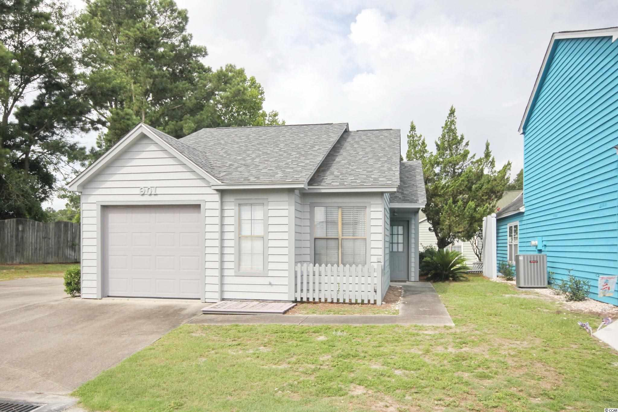 """Charming updated cottage on large lot at end of cul-se-sac just two minutes and a golf cart ride to the beach.  2 BR/2 BA with flex room which offers lots of possibilities as an office, playroom, craft room, etc...  Located in Lake Homes @ Belle Park.  Welcoming floor plan with tall ceilings, flex room built-ins, laminate floors in bedrooms, and living room fireplace with electric heater insert.  Improvements include smooth ceilings, wood look tiled floors in the kitchen; kitchen cabinets with under and inside cabinet lighting; natural stone quartzite countertops; glass tile backsplash; stainless steel kitchen appliances; newer bathroom vanities and toilets; and designer lighting, ceiling fans, and newer light switches.  The sliding door and side entry door were replaced in 2016 as was the roof. The HVAC was replaced is 2018.  Spacious yard with private rear patio.  One car garage with shelving,  pull down stairs for attic storage and washer/dryer. Low HOA includes pool, trash pick up, landscaping, common areas and common electric.  Seller has seldom occupied the property and it is being sold """"AS IS.""""  Highly desirable location close to restaurants, shopping, entertainment, golf, boating, the ATLANTIC OCEAN, and more!  Measurements are approximate and not guaranteed.  Buyer is responsible for verification."""
