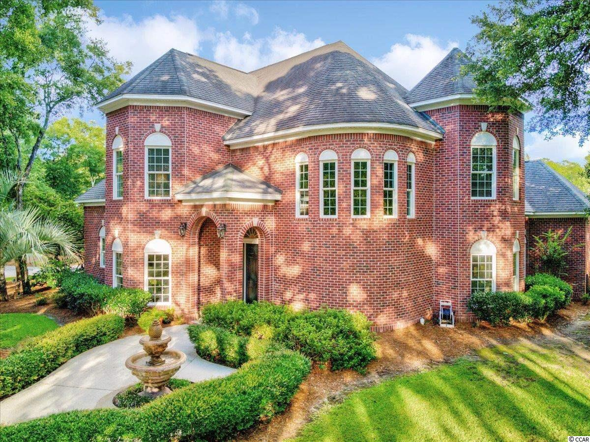 This stately home was built for a family that wants abundant space with executive design. Tucked away at the end of a cul-de-sac, you will find this all brick beauty that offers southern charm both inside and out. As you pull into the driveway, you will be mesmerized by the lush landscape and the serene sounds of trickling water from the front yard fountain. Once you enter the foyer, natural light spills in from the oversized windows illuminating the custom tile flooring, the grand staircase, and the architectural arched doorways. The first floor offers plenty of space for entertaining, including a formal dining room, and a grand living room featuring a gas fireplace. At the heart of the home, you will find a renovated kitchen with upgraded cabinets, stainless appliances, and granite countertops, as well as a quaint breakfast area. The master suite is generous in size and has many designer upgrades, such as French doors overlooking the pool, a double tray ceiling, wood flooring, and a custom master bath, as well as two walk-in closets. On the way upstairs, you will find a cozy home office and powder room. At the top of the grand staircase, you will find two well-appointed bedrooms with sprawling ceilings and beautiful views, as well as another bedroom with its own private bath. Not only will you find an upstairs family room overlooking the pool and gorgeous backyard, but there is also a vast bonus room that could be another bedroom or the perfect space for more relaxation and hobbies. You will have ample places to park vehicles and recreational toys with the three-car garage. Be sure to imagine yourself sitting outside in the screened Carolina room with a cold beverage as you appreciate the tranquility of the backyard and custom pool. This house has extra prestige with over two acres of land that allow you abundant room but also gives you much-desired privacy. All of this, and you are minutes away from fabulous local dining, quaint boutique shops, grocery stores, an