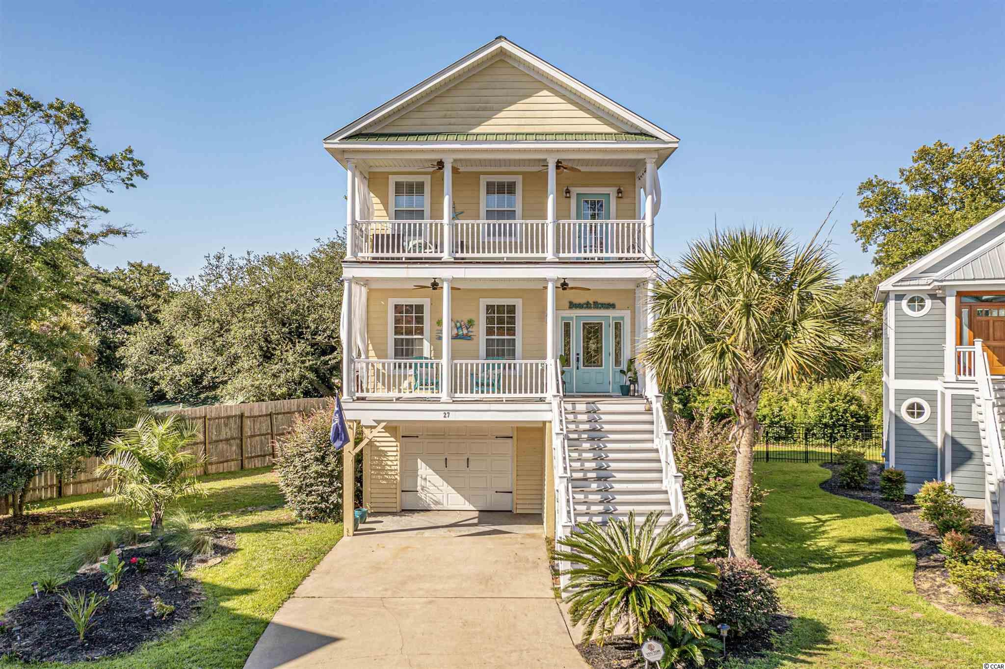 Welcome to the sought-after neighborhood of Creekside Cottages, located in the heart of Murrells Inlet. With the popular Marsh Walk just across the street, it is easy to feel like you're on permanent vacation with great restaurants, entertainment, marina and beaches available at your leisure. The neighborhood consists of beautiful raised beach homes, and this home you'll find is gorgeous from the inside out.  Tucked away on a quiet cul-de-sac with a water view. This 3 bedroom and 2 and a half bath home is a dream. Once you enter the home you will take notice of the open and bright floor plan, beautiful wood flooring throughout. The kitchen features stainless steel appliances, granite countertops, tons of storage, and a breakfast bar. Off the dining area you'll be able to walk out onto your screened in balcony and enjoy the peace and serenity of southern living. Speaking of balconies there are FOUR spacious balconies, one being a private upper sun deck. The master suite is stunning with a large bathroom, oversized tile shower, double sinks and linen closet. Under the home is the 2 plus car garage, with plenty of room for a golf cart or even a small boat. Schedule a showing before it's gone!