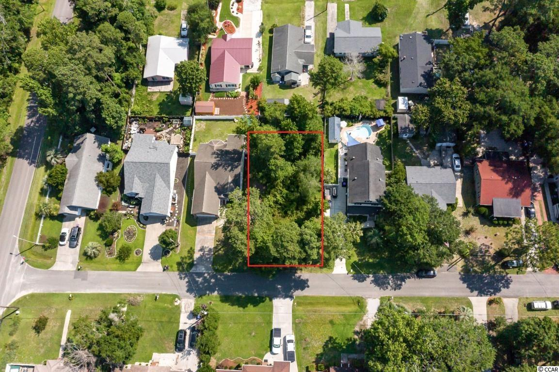 Don't miss this rare opportunity to build your dream home on this .17 acre lot with NO HOA, just a few blocks to the ocean in Surfside Beach! Perfectly situated close to parks, ball fields, the waterpark, and all of the Grand Strand's finest dining, shopping, golf, and entertainment attractions, with easy access to highway 17 and a short 5 minute golf cart ride to the beach. You won't want to miss this; schedule your showing today!