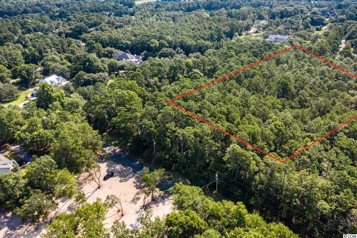 Don't miss this rare opportunity to build your dream home on this 3.8 acre lot with NO HOA, just a few blocks to the ocean in Pawleys Island! This lot has the ability to be subdivided into more than one lot, pending county approval. Perfectly situated close to all of the Grand Strand's finest dining, shopping, golf, and entertainment attractions, with easy access to highway 17 and a short 5 minute golf cart ride to the beach. You won't want to miss this; schedule your showing today!