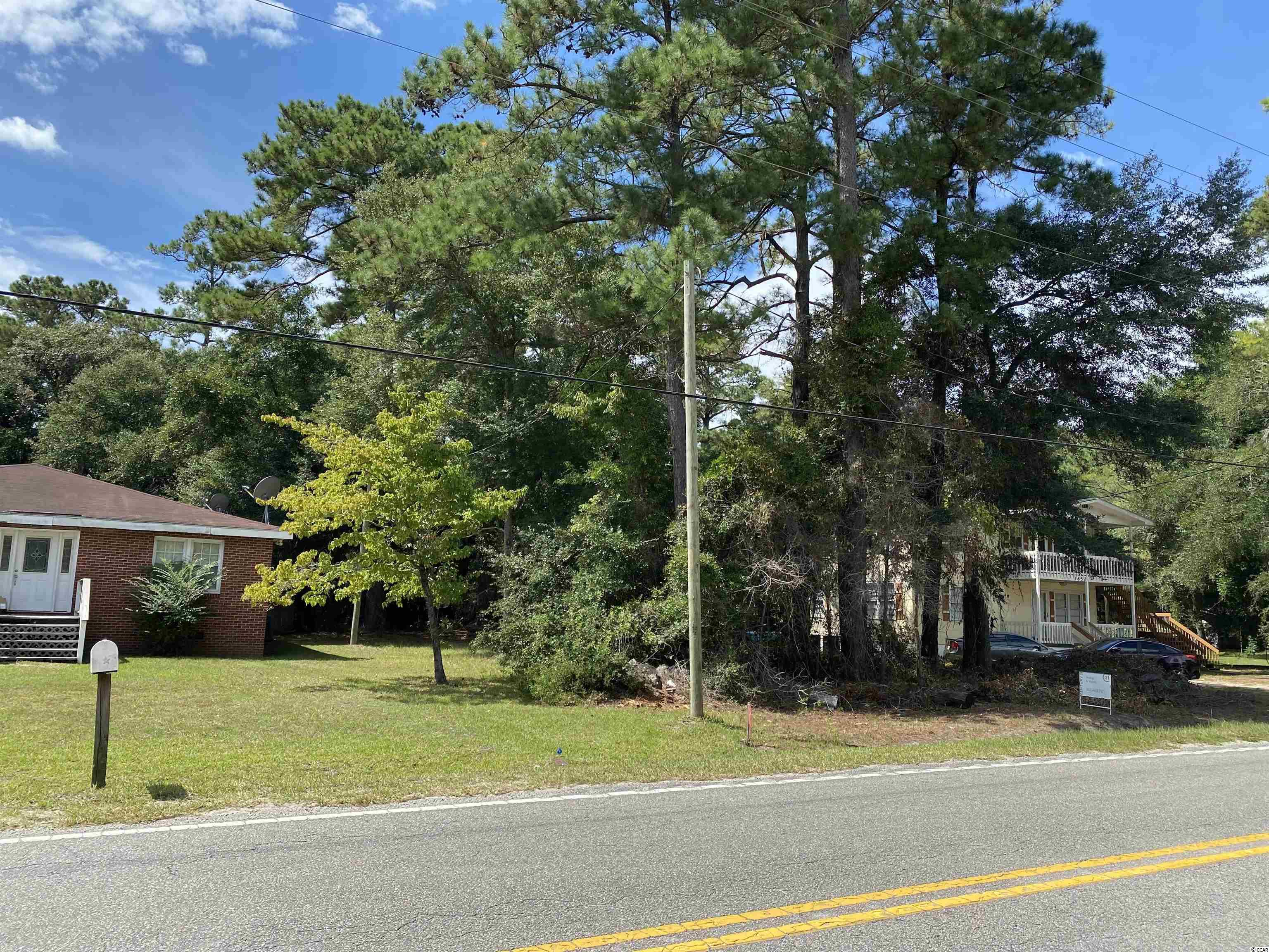 Great residential lot located on Highway 50 in Little River. No HOA, build your dream home or bring manufacture house there! Survey is available in associated docs! Close to shops, dining, entertainment, night life, golf, casino boats, marinas, Intracoastal Waterway, Cherry Grove Beach and everything North Myrtle Beach has to offer! Your time has come!