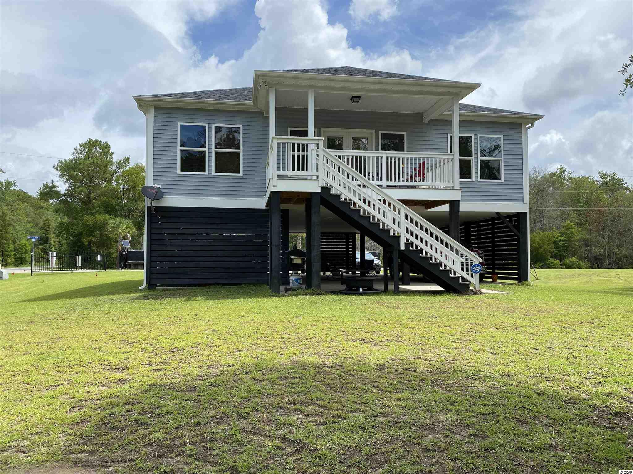Located on the Waccamaw river Conway sc, this 4 bed 2 bath, front covered porch, rear covered porch, security system, grand stand water and sewer, never been rented or smoked in home is a must to see. Water Oaks Landing, a private and gated community  is a one of a kind subdivision. Home was built in 2018.  This is a very unique area. Only one remaining lot left out of 16.  please call me for more info. The view is breath taking.