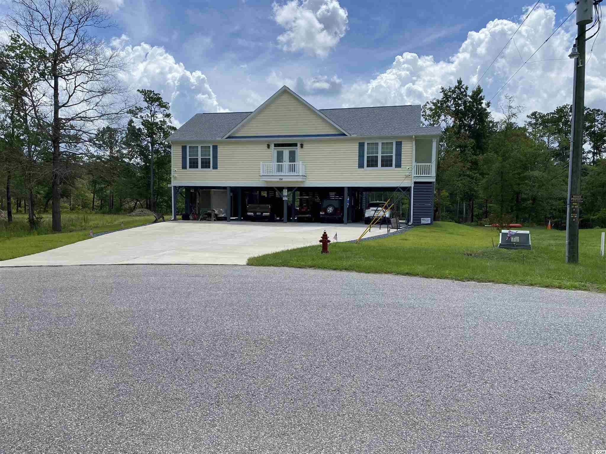 Beautiful custom built home ,2x6 exterior walls, all hardy plank trim, vinyl trex decking{99% maintenance free}, 10,000 lb. mooring whips on the dock, tankless gas hot water heater, interior walls all insulated, dual baking oven, dinette and 8 chairs convey. Home is located at the end of Lure ct. in the cul de sac. this home has a hard wired camera security system inside and outside. All appliances convey also the washer and dryer. lots of storage and parking under the home, also a huge drive way in front of the house. Private gated community dock to land your jet ski or boats. 22 miles to Conway on the waccamaw and 11 by car, this home is a must  see. Lots of other things to talk about.