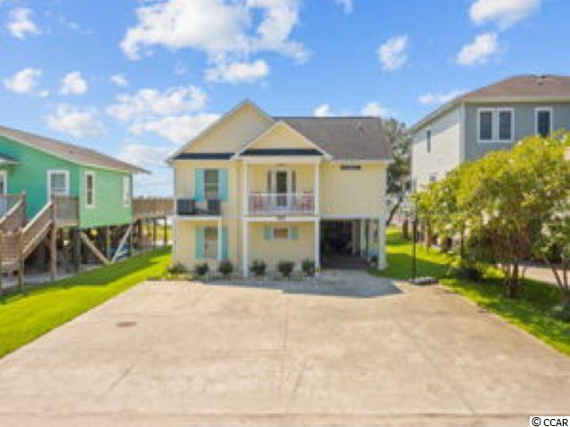 IF you are looking for the perfect home to enjoy the creek and inlet lifestyle, you have found it.  Beautiful creek house with pier and boat dock right out your back door.  Be fishing, crabbing or enjoying a leisurely boat ride to the Murrells Inlet Marsh Walk in minutes.  Easy access to the jetties as well.  Home was completely remodeled in 2015 by owner, who is a SC Licensed contractor.  Please take time to view the virtual tour.  It will really define the living experience which you as owner will cherish for a longtime.