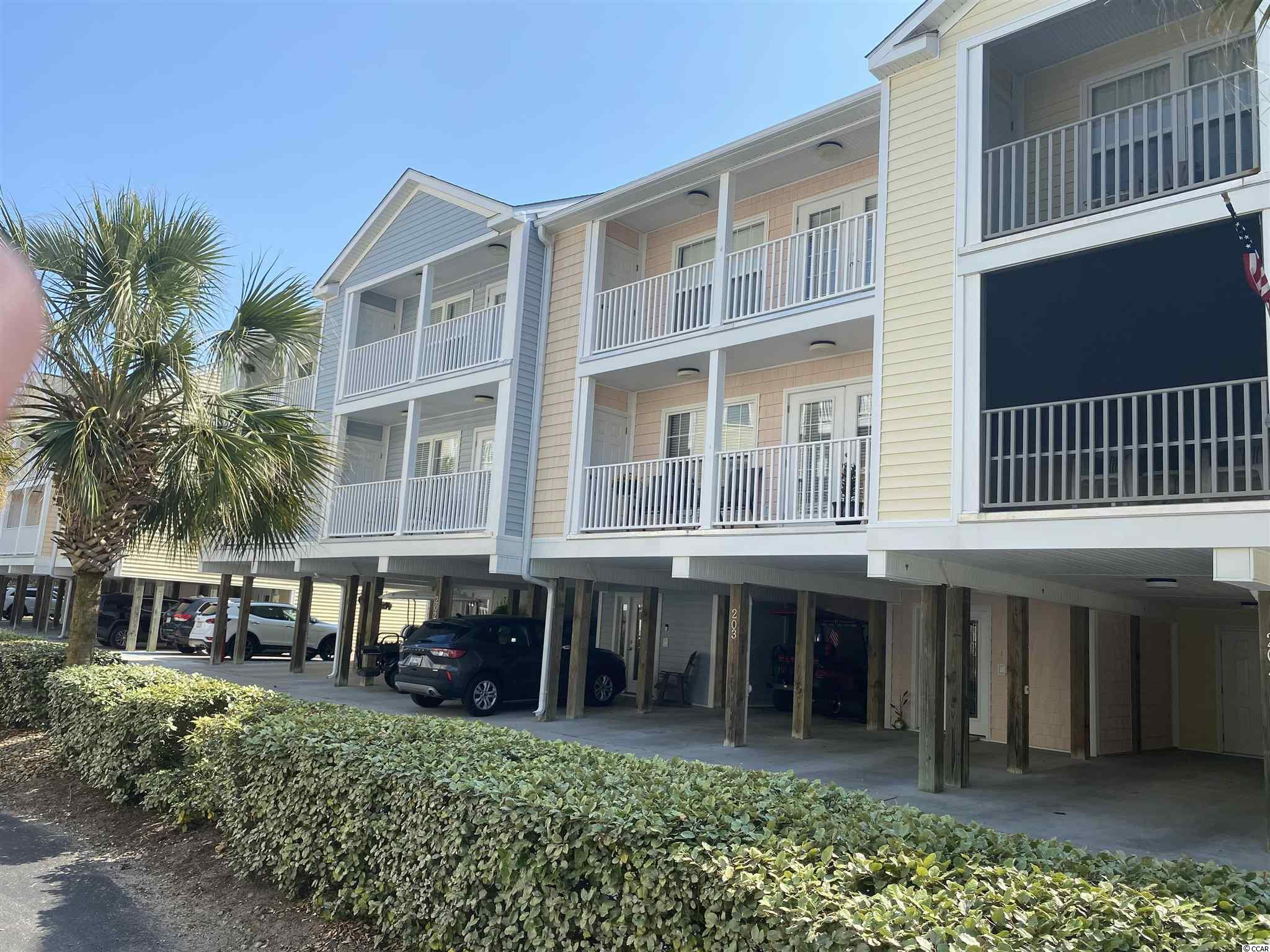 Walk to the Ocean! Located in the Tilghman Beach section of NMB, this 3 story Raised Beach/Townhome style home is in excellent condition and offers: 3 Bedrooms, 3 Baths, Granite Counter Tops, Interior Elevator, Crown Moldings, Golf Cart Storage, Community Pool and is within walking distance to the Ocean.
