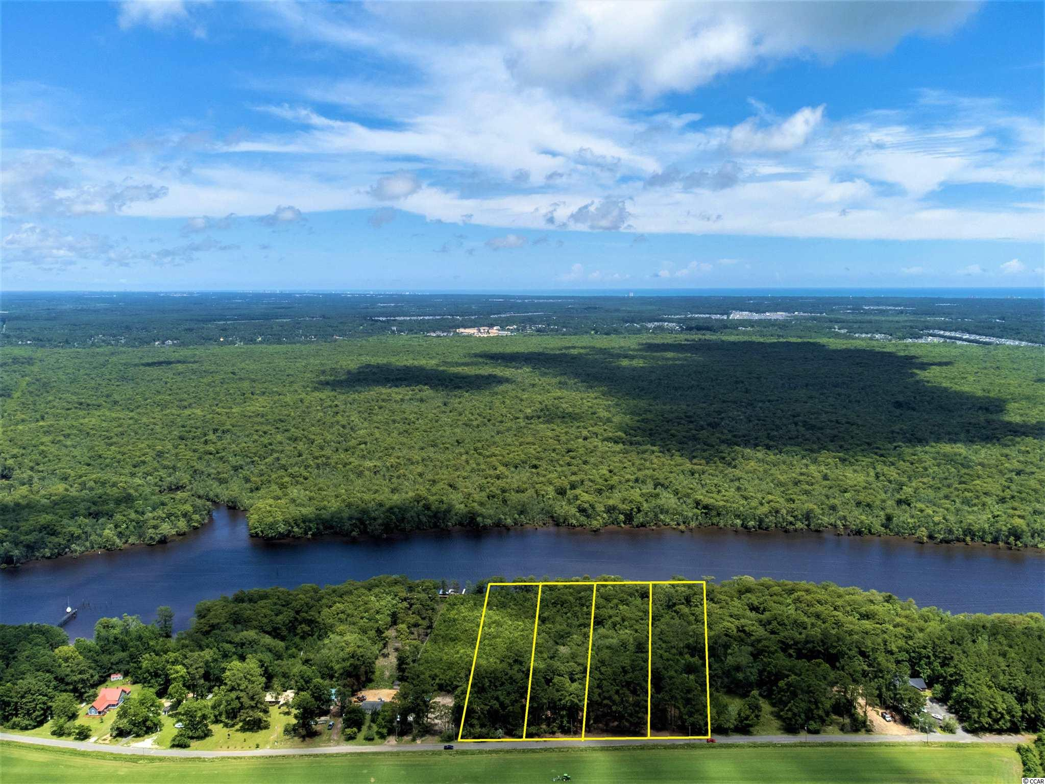 Excellent opportunity to buy larger than average waterfront lots directly on the Waccamaw River and ICW next to the currently expanding Bucksport marina. See videos and pictures.  Sewer available with Grand Strand Sewer and Water Water available with Bucksport Water ** Coming in the future is an expressway linking Bucksport and Surfside Beach, dramatically increasing desirability in this area.