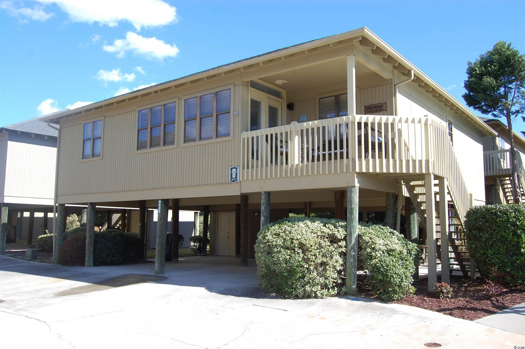 This is a rare opportunity to own a 4 bedroom / 3 bath,  well maintained,  Guest Cottage in the Shore Drive section of Myrtle Beach.  Only a short walk to the Ocean and a few steps to one of the exterior pools. Sold furnished including the linens so you only need to bring your toothbrush. To many updates to list but some are waterproof vinyl plank flooring in the living areas, thermo pane windows and updated bathrooms.  The HOA takes care of the cottage exterior, roof (#59 was replaced in 2008) and landscape.  This cottage is immaculate and spacious with all 4 bedrooms opening up to the large Living room.  A room off of the living room that can be used as a dining room  or Carolina room and opens to the front porch.  Wonderful outdoor living space under the cottage with 2 storage closets, one large enough to store your own golf cart.