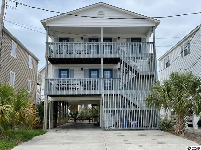 Mark owning a home at the beach off of your bucket list with this beautiful, spacious 5 bedroom 4 baths home! A quick 300 foot walk will have you lounging by the ocean. This home is located in Cherry Grove Beach, SC named one of the Nation's best family beaches. This home will be perfect for family living or a rental income. It also has the potential to be easily turned into two separate units if desired. There is also a room on the ground level that would be a perfect space to use for grilling or cooking with family and friends and includes a full shower. Also featured are two large front porches for morning coffee's or relaxing evenings listening to the sounds of the ocean.  Buyer is responsible for verifying all information.