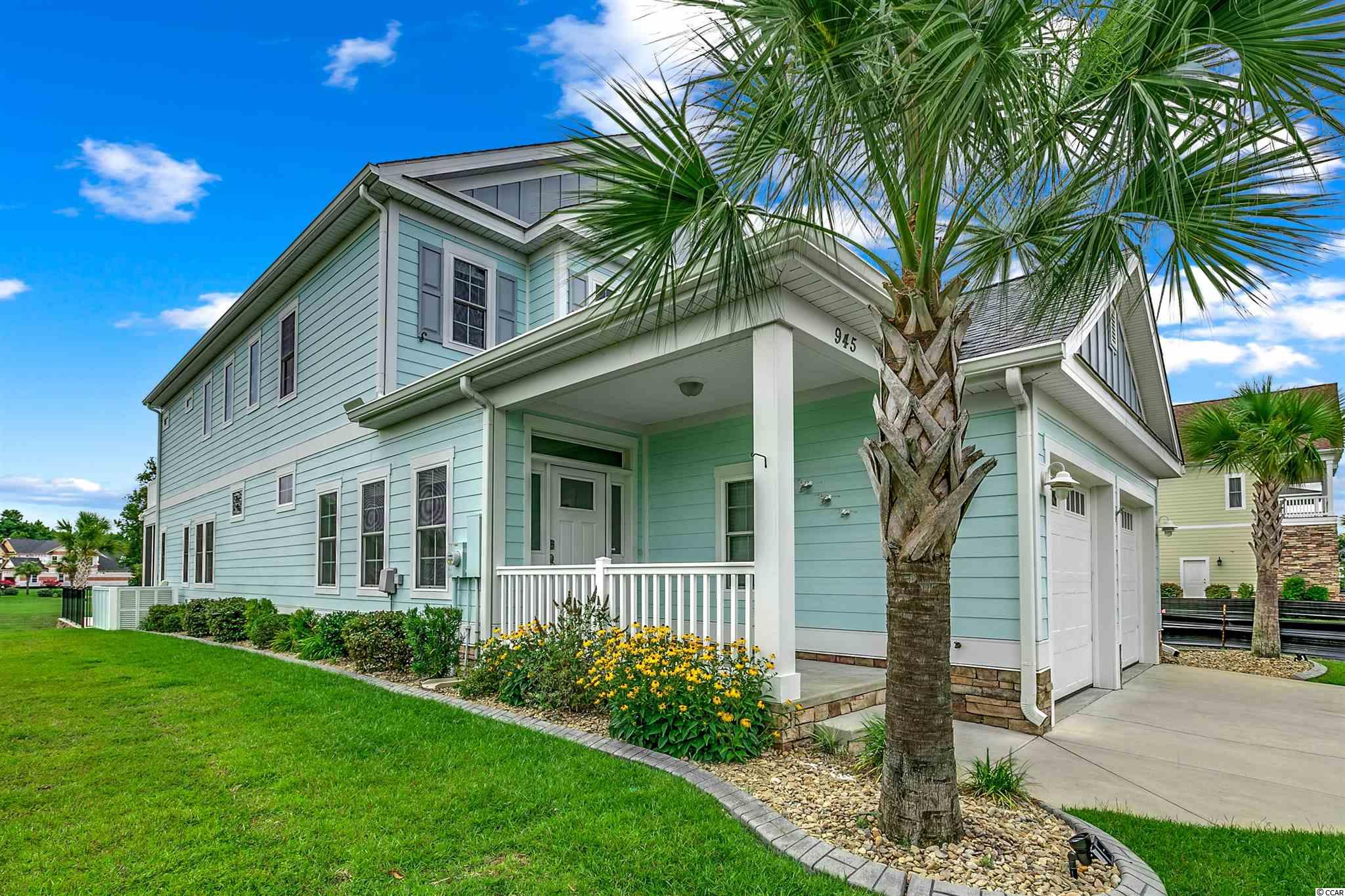 This stunning, one of a kind 5 bedroom, 4 bath custom-built builder's model has an open floor plan with plenty of natural light as well as breathtaking views of the pool, lake and sky.  Located in the gated and prestigious Waterway Palms Plantation neighborhood this turn key home is situated one block from the Intracoastal Waterway. When entering this immaculate and recent professionally painted home from the covered porch, you are greeted with soaring 2 story ceilings with wood grain plank tiles. There is a large modern chef's kitchen with tall cabinets topped with glassed display features, subway tile, gas stove, granite island, stainless appliances, breakfast nook and cozy benched alcove with a matching granite table and large walk-in Pantry. Adjacent to the kitchen is the living room with tray ceilings followed by the outdoor area which includes a Lanai with Eze-breeze windows and ample decking around the pool, perfect for entertaining. The spacious Master Suite which has direct views of the pool and lake.  A bedroom/office is also on the first floor. Upstairs, there is an open hallway concept providing an impressive view of the first level including a lofted sitting area/Den with a large deck boasting a beautiful view of the lake, pool and the absolutely gorgeous sunsets.  There are also three carpeted bedrooms and tiled bathrooms. This custom-built home features 2x6 construction, 24x12 salt water pool with heater/cooler and fence, Hardie Board siding, security system, irrigation, supplemental gas furnace to augment the heat pump on cold days, Rinnai tankless water heater and 2 car garage. The home has many upgrades including custom moulding, updated closet system, granite countertops and transom accent windows throughout. The community has a private clubhouse (gym, kitchen, functions area, pool table, multiple outdoor sittings), resort-style pool, children's pool, tennis courts, basketball area, playground, boat/RV storage, boat launch ramp, walking and biking
