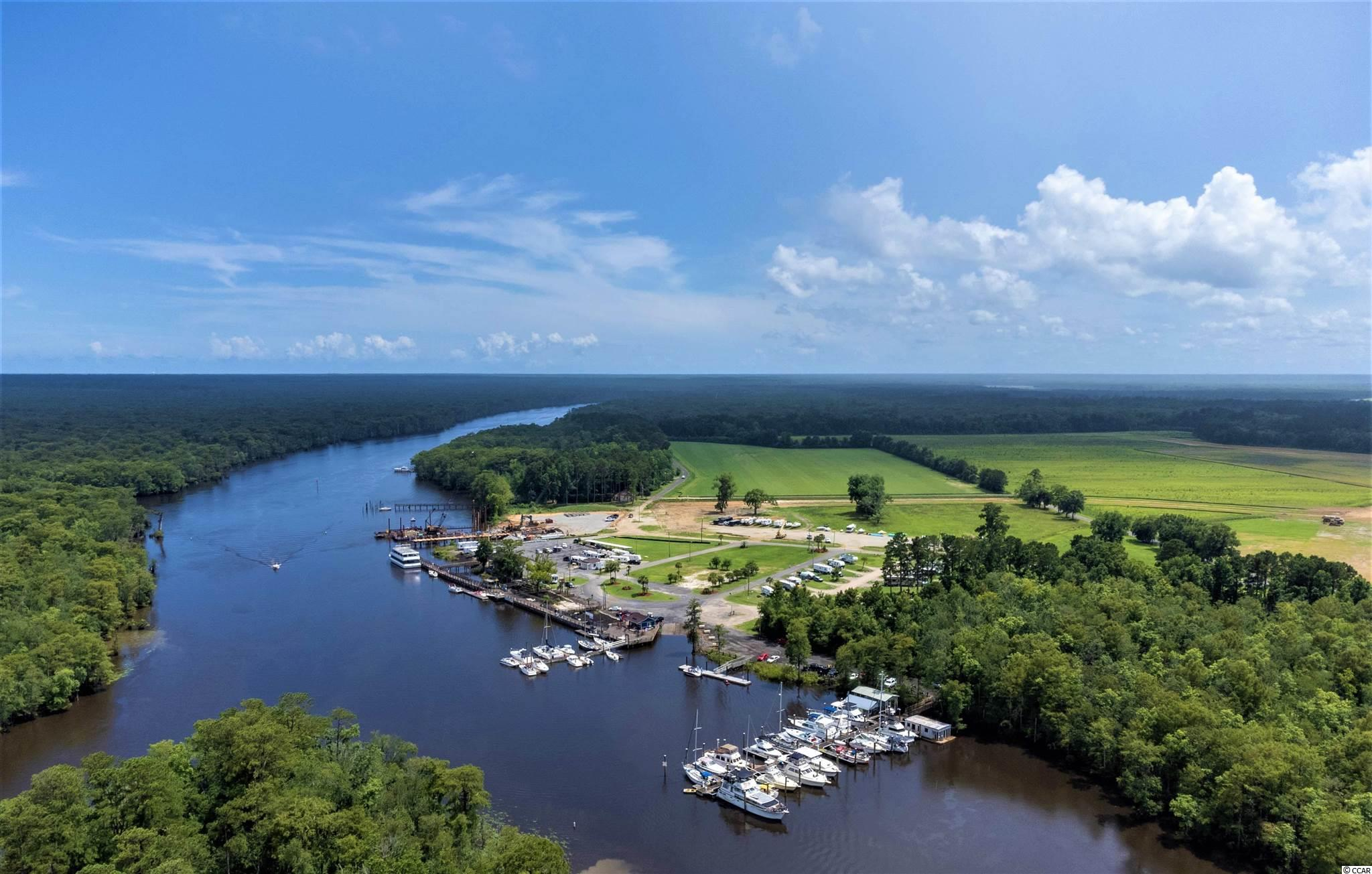 Excellent opportunity to buy larger than average waterfront lots next to the currently expanding Bucksport marina. See videos and pictures.  Sewer available with Grand Strand Sewer and Water Water available with Bucksport Water ** Coming in the future is an expressway linking Bucksport and Surfside Beach, dramatically increasing desirability in this area.
