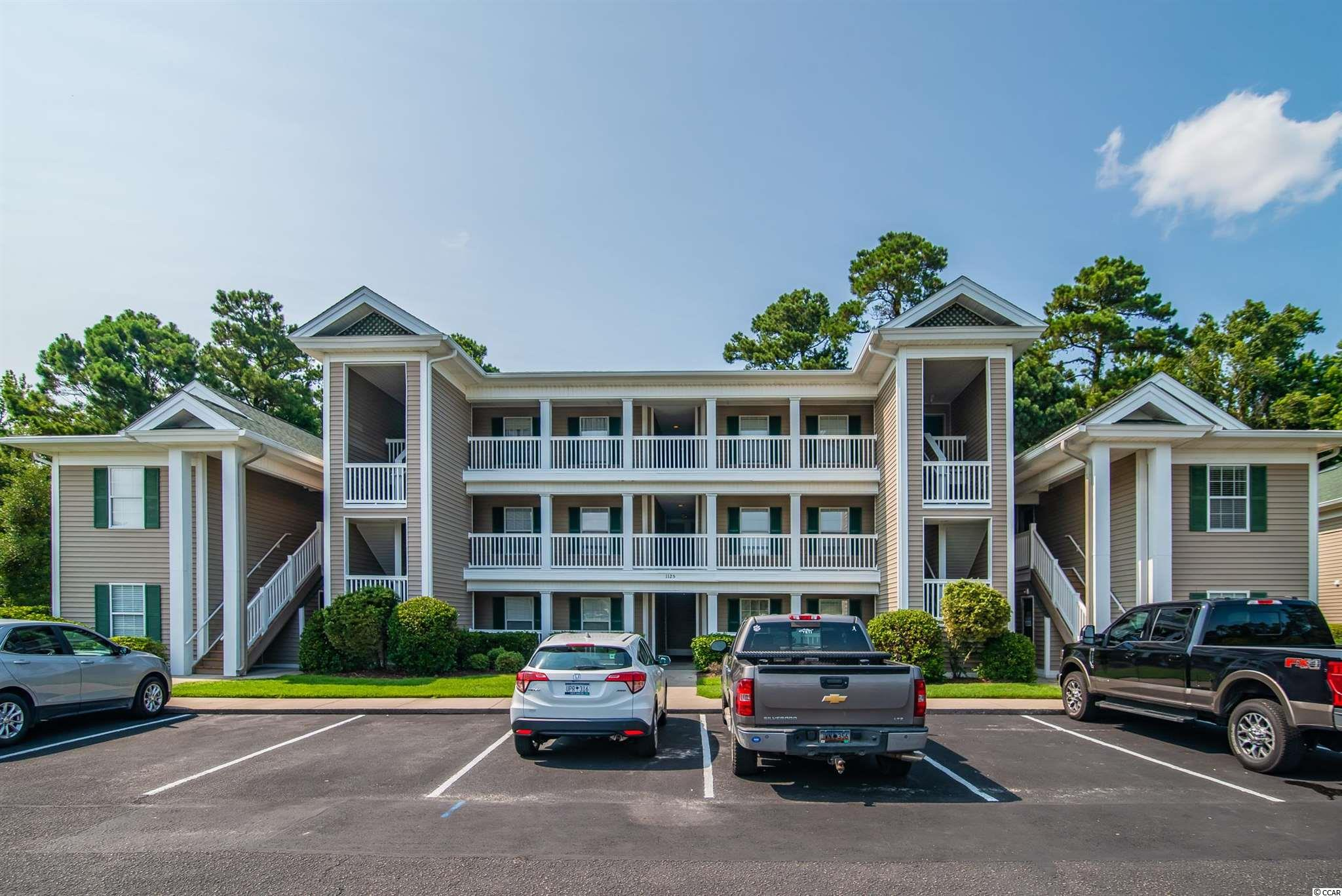 Three bedroom, two bath unit located in True Blue. Partially furnished with new carpet and vaulted ceiling.  Located on 3rd floor with outdoor storage and close to the beach.