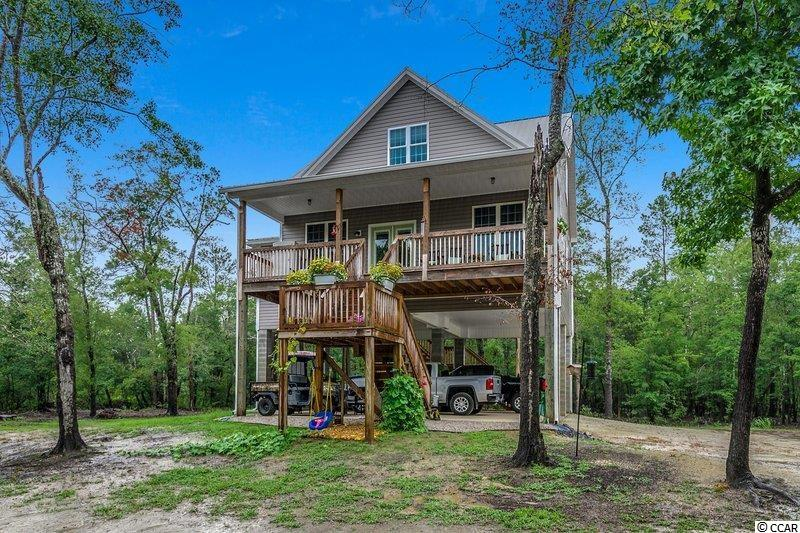 You don't want to miss this waterfront, private living on 3.55 Acres. This home was built in 2019 and has been very well maintained.  3 BR/ 2 1/2 BA's on the Waccamaw River. There is your very own boat ramp on the property. Gutters, tankless hot water heater and is even wired for a generator. The house features knotty pine counter tops, a gas stove, breakfast bar/work island. Wake up every morning to this beautiful view from your Master Suite.