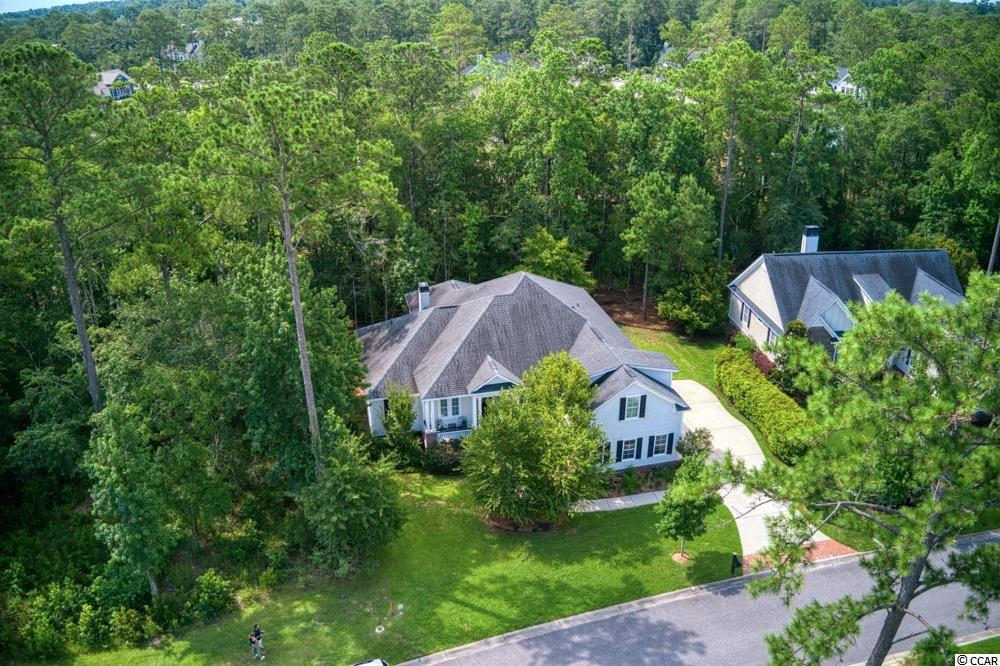 """Don't Miss out on your opportunity to start living your dream life at Family Friendly Collins Creek Landing. This is a highly desired area that is convenient and private, yet full of the amenities you want and deserve! This Semi Custom designed 4BR 3 1/2 Bath home has lots of upgrades & a family friendly layout with a Split floor plan; two Large BR's on the left side of the home and the Master on the right plus a fabulous Bonus Room/ Man Cave over the Garage with it's own Full Bath. This wonderful Low Country Style home has a beautiful lot and you'll love entrance to your home with Bead Board Ceilings and a fresh coat of Paint on the Front Porch. As you enter the foyer you will be drawn into the home that boasts High End Crown Molded Ceilings, Real Hardwood Flooring, a Gorgeous Formal Dining Room highlighted by a high end Chandelier, Spacious Family Room with Fireplace, and Custom Built-in shelves The Chef's Kitchen is well appointed with double oven, Custom Cabinets & Granite, wine shelf, and a lovely corner Breakfast nook. Immediately your eyes will catch a glimpse of the what will become one of your favorite rooms in the home, a wonderfully designed oversized Screened in Porch. Many a lazy day and memories will take place here and there is room to add an indoor Fire pit as well. Step out the Back Porch Screened door to the patio that's the perfect space for an outdoor kitchen with both a Gas line and Water line already in place. There is a nice buffer of trees left for a more private back yard. Heading back in the home don't miss the added Powder room for guests plus the 2 Guest BR's Bedrooms that share a Hall Bathroom that is tiled and boasts a gorgeous Seamless Shower. Then of course there is """"The Master Suite"""" which is fabulous; complete with heavy crown molding & Tray Ceiling leading into your little oasis; the Master Suite Bath that features beautiful tile, Separate Seamless Shower, Double Sink Vanity, Custom Claw Foot Tub, and a Huge Walk-in Closet. You'll """