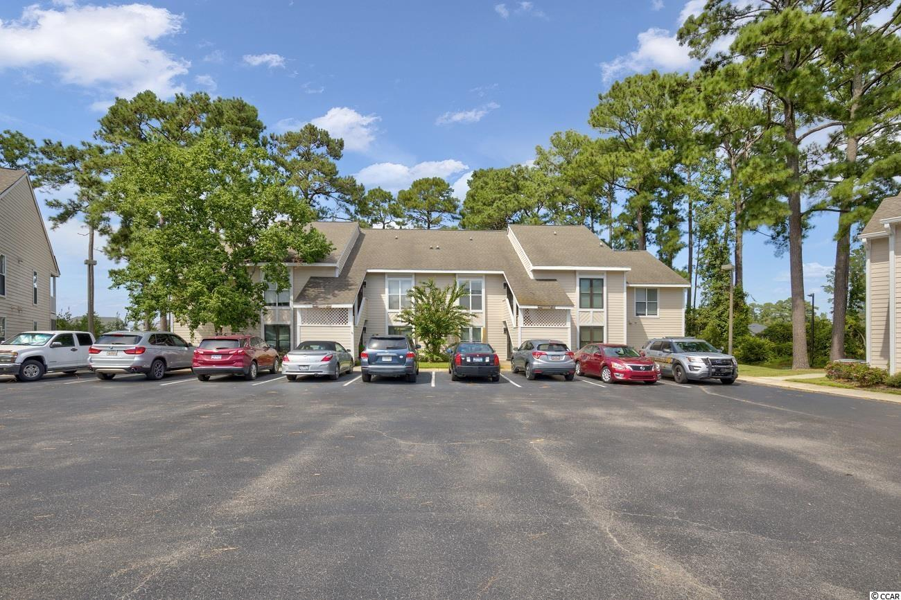 This well maintained 2BR 2BA villa is nestled back in this development with a beautiful backdrop of trees, open space and a buffered pond view of adjoining Bridgewater. Upon entry you will be greeting with a 1.5 story versatile floor plan.  The living room is open and boasts a soaring vaulted ceiling with sky lights allowing natural light to flow freely into the space - there is also an inviting screened porch.  The kitchen is open to the living area and features updated solid surface counters and breakfast bar, tiled backsplash, large pantry and newer appliances. A bedroom (which current owner uses as the master BR) and full hall bath complete the main level.  The 2nd bedroom is an oversized loft with double closets, private bath with double sinks and includes a computer nook or place or reading spot. This loft could easily double as an office/second living space.  There is good storage throughout.  Community pools, tennis and grilling areas.  Conveniently located just minutes to the beach, hospital,  and all the attractions of Little River, North Myrtle Beach and Hwy 31.
