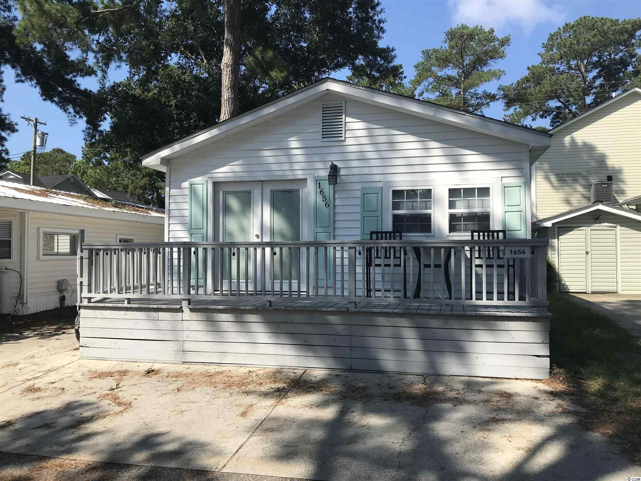 New tile shower, New water heater, New front storm door with built in blinds, New washer & dryer, remodeled bathroom in master. Golf cart conveys with sale