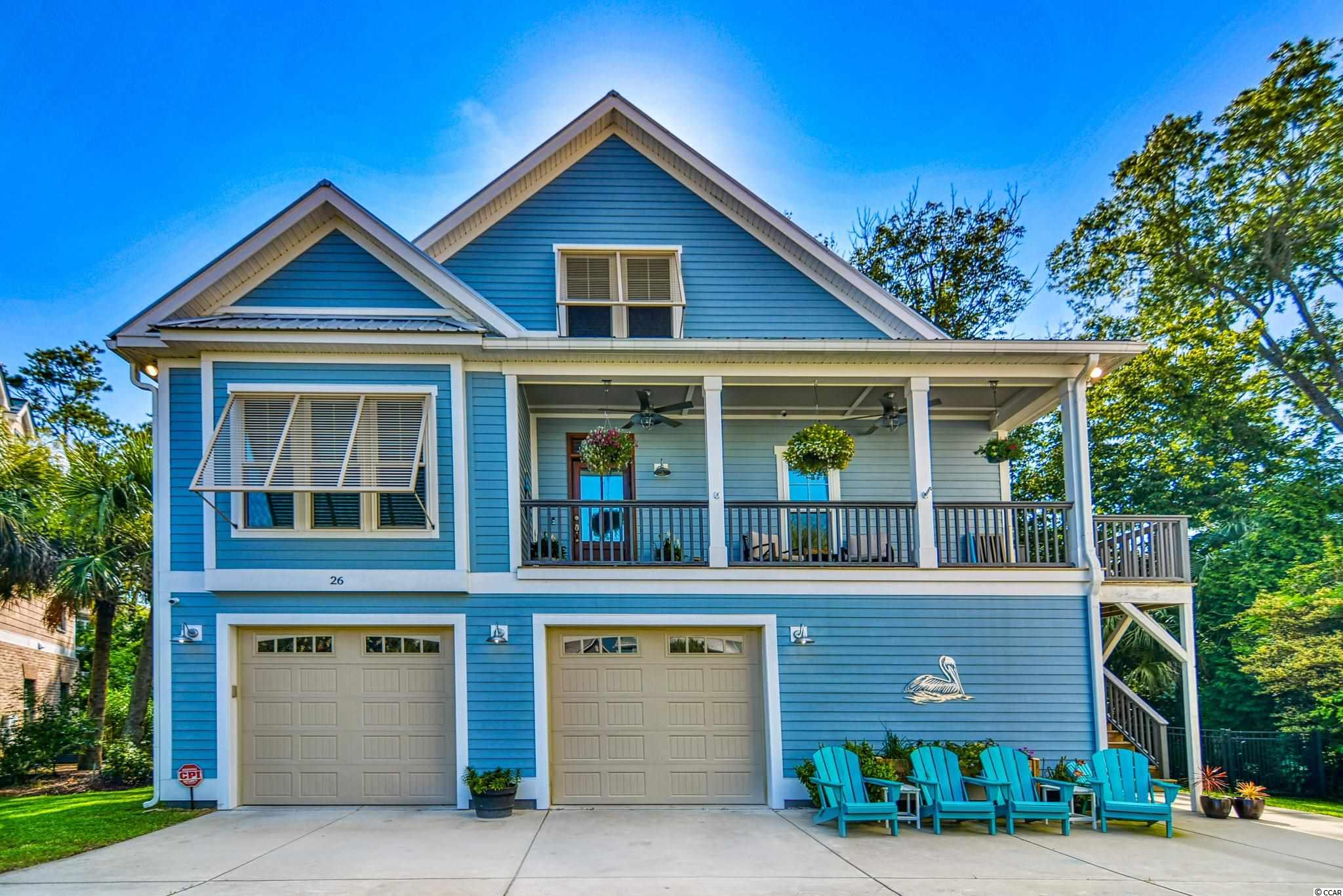 Walk to the Marsh Walk from this beautiful 4bed/3.5ba home in Creekside Cottages. This home is a boater's dream with an OVER-SIZED, 2 BAY GARAGE that will accommodate a large center-console boat AND golf cart in 1 bay and 2 SUVs in the other. Home is ELEVATOR-READY with shaft from ground floor up to the main living area/master. While not in use, this space offers lots of additional storage space. On the ground floor, you will find a 1bed/1ba PRIVATE-ENTRY SUITE accessible via the garage OR side-yard. Laundry on this floor, as well. Because of the separate entry, it's the perfect office, mother-in-law suite or guest suite. With over 4500 total sqft, this house boasts several COVERED DECKS including the front porch AND a large grilling porch on the ground floor right off the FENCED-IN yard. Plus, the house is ready with an INVISIBLE FENCE so your pups can roam the entire property while you enjoy the outdoors. Main floor is light, airy and open and includes a large living room, eat-in kitchen with GAS STOVE that opens out to the large L-shaped SCREEN PORCH. Master is on this floor and has private access to the screen porch, a cozy sitting area and the bathroom has been updated with a custom tile shower, double-sink vanity and walk-in closet. 2nd floor has 2beds/1ba AND LIVING ROOM LANDING with plenty of room for gaming, TV or playroom space. On the CUL-DE-SAC and surrounded by MATURE TREES and LUSH LANDSCAPING this home offers tons of privacy but you can WALK TO to everything Murrells Inlet has to offer including; PUBLIC BOAT LANDING, marinas, docks, restaurants, and shops. Brookgreen Gardens Huntington State Park, bike trails and the beach are just a 5 minute drive. Only 12 miles north you'll find everything Myrtle Beach has to offer including: Myrtle Beach International Airport, Broadway At The Beach, The Market Common, Coastal Grande Mall, 2-Tanger Outlets, Barefoot Resort and Coastal Carolina University (CCU), marinas, public docks, landings, restaurants, golf cour