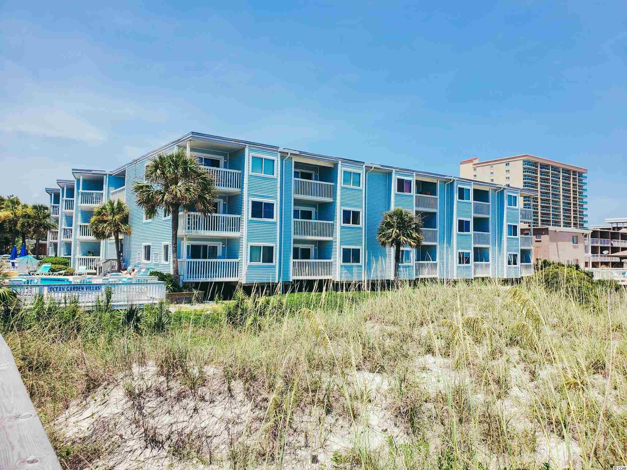 Beautiful DIRECT OCEAN FRONT 2 bedroom/2 bathroom condo in the Crescent Beach section of North Myrtle Beach. This condo is perfectly situated in the complex, being on the second floor which lets you take advantage of the ocean views over the dunes but you have less stairs than the third floor.  Owners have updated the flooring - there is no carpet in the condo!  They have also updated both bathrooms - both have beautiful tile work.  The washer and dryer have also been replaced recently, with new high end Samsung units.  The balcony overlooking the ocean is desirable because it is large AND private.  The views from inside and out are spectacular!  The condo comes fully furnished and the sofa has a pull out bed.  NEW hot water heater installed July 2021!!  Owners are allowed pets in this building.  There is also a beautiful community pool in between the buildings and a couple of charcoal grills for you to use.  The HOA fees include building insurance, water, sewer, trash, pest control, cable and high speed internet.  The location of this building is ideal - less than 2 miles South of Main Street and just over 2.5 miles to Barefoot Landing!  You are truly close to so many attractions, restaurants and shopping opportunities! Be sure to check out the immersive virtual tour and schedule your showing today before this one is gone!