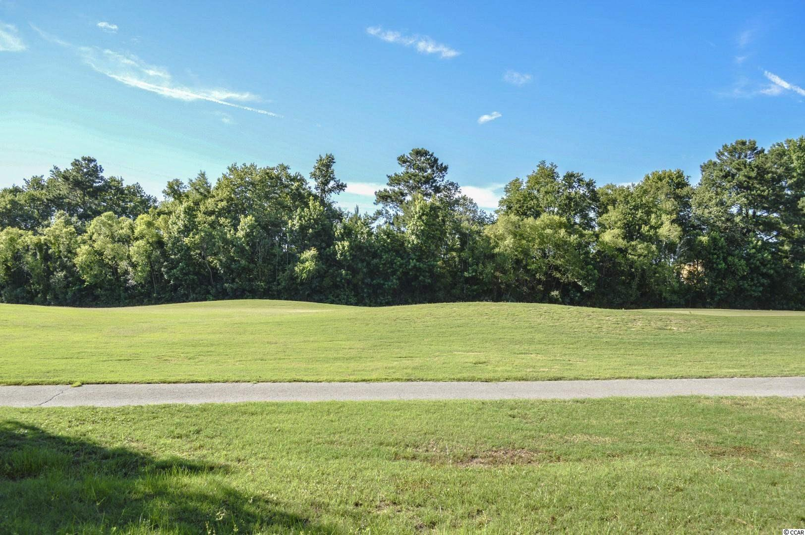 """PRIME 0.48 acre golf course lot in Wild Wing Plantation. Lot is located on the #2 Fairway of """"The Hummingbird"""" golf course. One of only two lots left along this fairway. WIDE BACK with incredible views. Top of the line community amenities - 180 acres of lakes, 27 holes of golf, clubhouse with fitness center, driving range, 3 pools, waterslide, splash fountain, basketball courts, tennis courts, playground, day docks and boardwalk. Close to CCU, HGTC, Conway Hospital, downtown Conway, shopping, dining, and entertainment. Short drive to the beach and everything downtown Myrtle Beach has to offer. Enjoy the comforts that come with NEW and build the home of your dreams on this prime golf course lot!"""