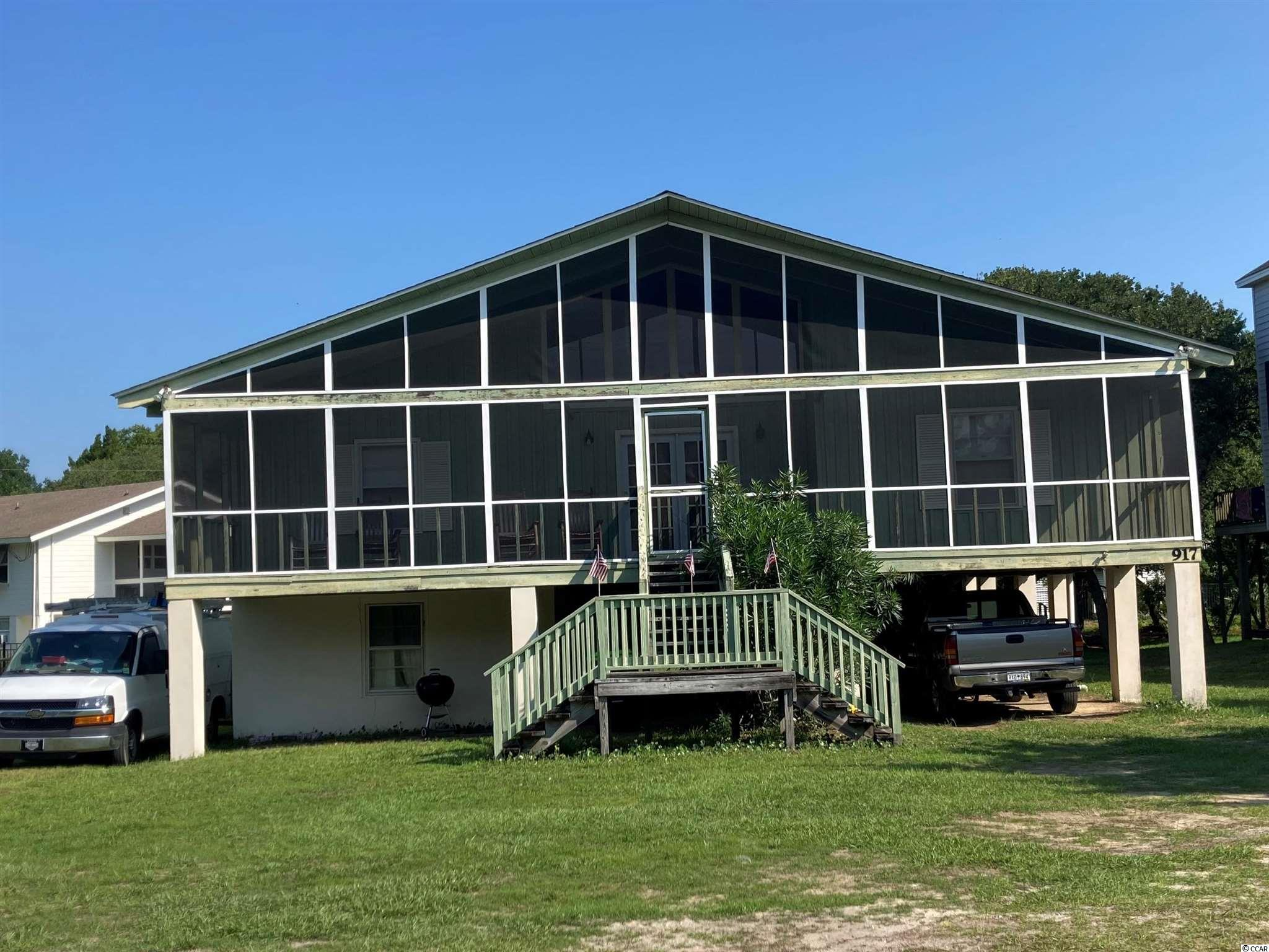 """Loving this charming, raised beach home steps away from the water in this North Litchfield Beach community. Open concept living and dining room. Very spacious, with a vast screened in porch to enjoy your early morning coffee while the sun comes up and just as amazing relaxing at the end of the day as the sun goes down. The """"Sawmill House"""" was built by a Georgetown family that owned timber land and a sawmill. The lumber and timber were selected and milled at the family's sawmill. Great bones, level floors, beautiful cathedral ceilings, Roof 2020, HVAC 2018, New mattresses 2020, New flooring 2020, furniture stays. Call for an appointment and make this beach home yours today!"""