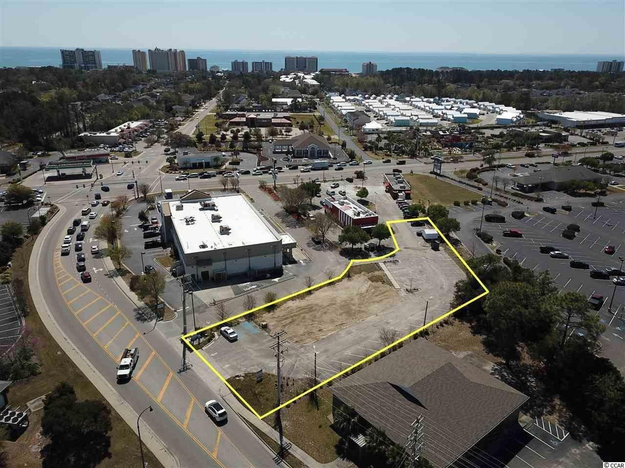 Over 2/3 of an acre (0.67 acres) commercial lot with asphalt parking lot of 36 parking spaces on 6th Ave S in the City of North Myrtle Beach, just south of Robert Edge Pkwy and Main St. Subject property has excellent access via the signalized intersection at 6th Ave S and also via the Hwy 17 entrances into KFC, Waffle House & Walgreens. Other Anchors nearby include 2 banks, North Strand ER, Big Lots.  This is a prime location for an office/professional, restaurant, retail, or other commercial use. HC zoning.
