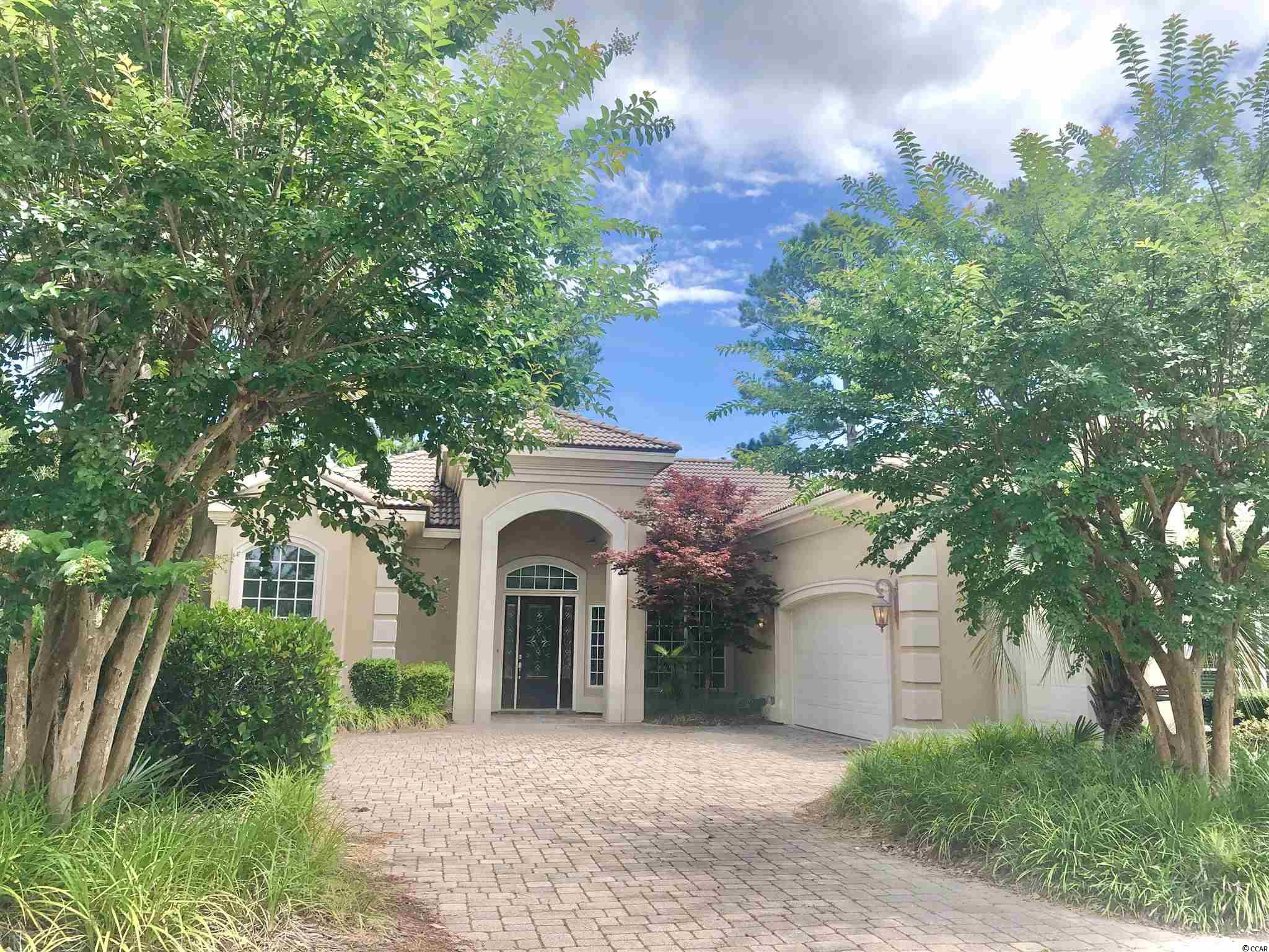 Located in the Prestigious Gated Golf Community - Grande Dunes! This Beautifully Renovated 3 Bedroom 2 Bath Home will not last long! Boasting High Ceilings, Updated Flooring, Fresh Paint, Luxury Tiled Bathrooms, 3 Car Garage, Golf Course View & So Much More! Amenities include a 25,000 square foot OceanClub with fine dining, an oceanfront pool deck with food & beverage service, meeting rooms and tons of fun activities! The community also has two 18-hole golf courses, several on-site restaurants, a deep water marina, tennis facility and miles of biking/walking trails!