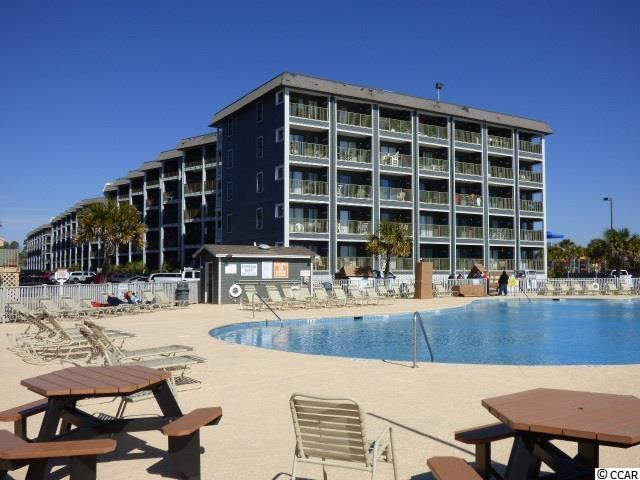This beautifully decorated, modern, and chic Oceanfront 1 Bedroom/1 Bath condo in the 3rd Floor of the A Building of Myrtle Beach Resort offers views of the Beautiful Blue Atlantic and the beach from throughout the entire living area. So many updates including newer cabinets, countertops, baker's rack, and appliances in the kitchen, tile floors throughout, an all tile walk-in shower, ceiling fan in the bedroom, and recessed lighting in the kitchen/living area. Enjoy the sounds of the ocean or people frolicking in the large Oceanfront pool just outside this wonderfully remodeled condo or watch the sunrise over the horizon. So many updates including newer cabinets, countertops, and appliances in the kitchen, tile floors throughout, an all tile walk-in shower, ceiling fan in the bedroom, and recessed lighting in the kitchen/living area. Then there's taking it all in form the spacious balcony where you may never want to leave to enjoy all this wonderful resort surrounding you has to offer. Myrtle Beach Resort is a 33-acre gated oceanfront community with many amenities including six pools with two indoors, a lazy river, hot tubs, saunas, tennis courts, fitness rooms, bocce court, game room, 24-hour security, and activities for all ages from playgrounds to a beachfront bar & grill. Conveniently located on Highway 17 just north of SR 544, Myrtle Beach Resort is convenient to all the area has to offer. Square footage is approximate and not guaranteed. Buyer responsible for verification.