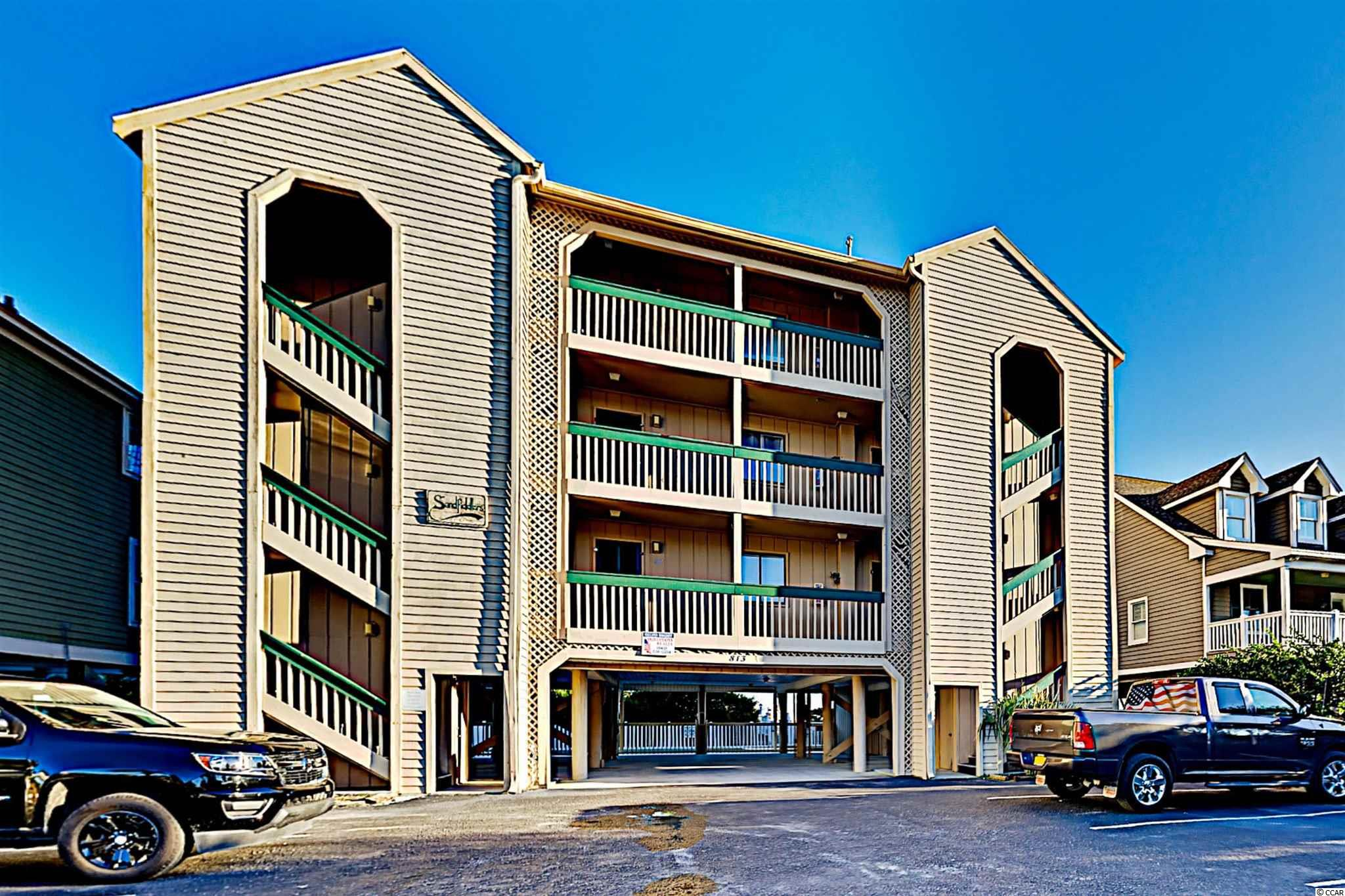 Sand Fiddler is a quiet nine unit building nestled along the oceanfront in Surfside Beach, SC with a private pool and direct beach access.  This unit is a must see.  First floor unit with a beautiful view of the ocean.  It has been completely remodeled from ceiling to floor.  Luxury flooring throughout, quartz countertops, tile backsplash, brand new stainless appliances, and many more upgrades.  This unit will be sold fully furnished and move in ready. Enjoy your morning coffee on the deck overlooking the pool and ocean.  This view could be yours to enjoy along with the ability to draw solid rental income.  Agent is related to the seller.