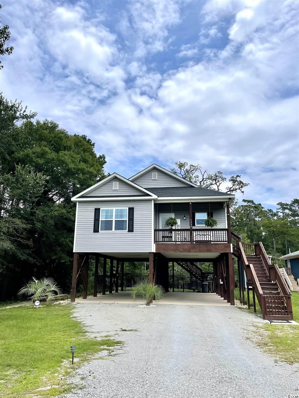 Here is a beautiful 2 BR 2 BA riverfront home minutes away from the beach.  The home was custom built featuring custom cabinets, granite countertops, stainless appliances, and much more for luxury living.  There are porches for sitting, cooking, and enjoying the outdoor area overlooking the river.  There is a fenced backyard for pets.  Perfect for the folks who want to be away from the rules of an HOA, but be close enough to town and activities.  This home would also make a great second home to enjoy both the river and the beach.