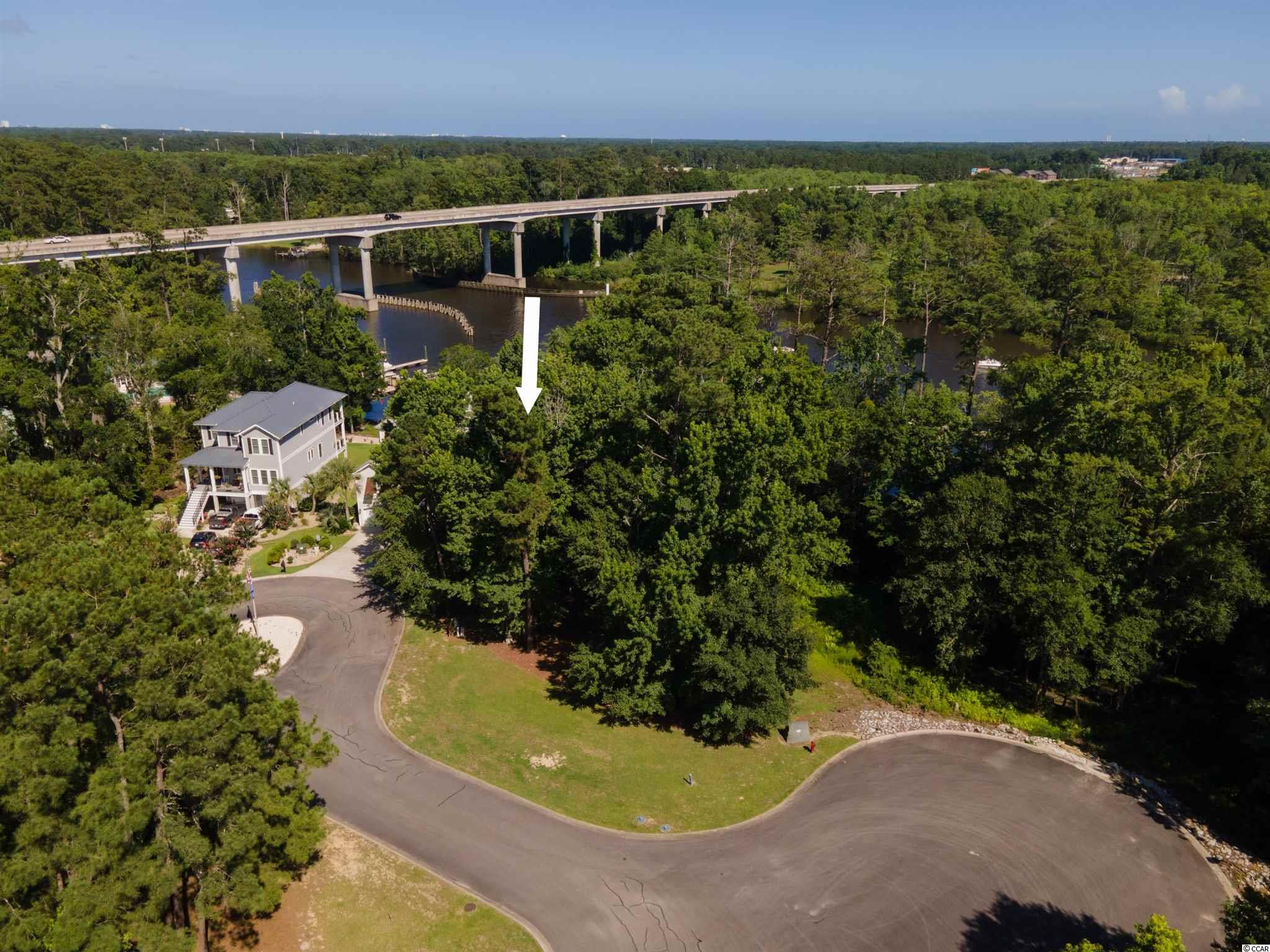 Once in a lifetime opportunity to build your dream home in a gated Intracoastal Waterway community. One of the only remaining waterfront lots in the unique Harbor Oaks Marina. Walk to the community clubhouse, playground and pool. Enjoy the incredible amenities this neighborhood has to offer. Lot also includes a private 50 foot boat slip.   Come build your dream home today!