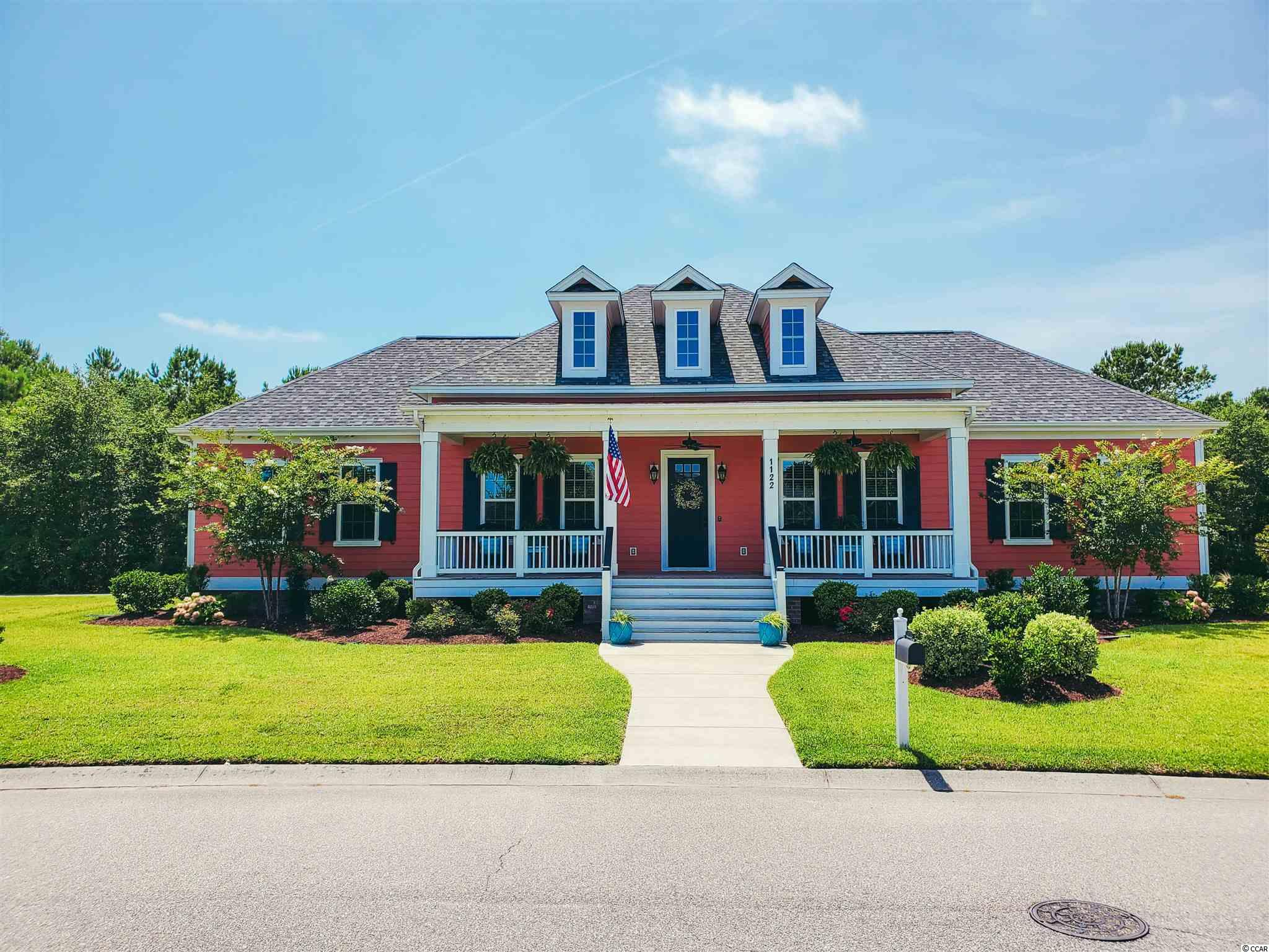 Absolutely stunning 3BR/3.5BA ranch in the beautiful Charleston Landing neighborhood - just minutes to Cherry Grove Beach!  Believe us when we say that this home is straight out of a magazine!  From top to bottom, it is finished beautifully and well maintained.  From the custom trim details, to the oversized barn doors to the designer tile work - everything about this home screams Southern Charm.  The kitchen has classic quartz countertops, stainless appliances, huge island, custom pantry door, built in desk area, beadboard ceiling and more!  And let's talk about the master bedroom - wow!  It is so spacious with plenty of room for a sitting area and king sized bed.  The his and hers walk in closets are large as well.  And the master bath - this is truly the icing on the cake.  The oversized walk in shower, stand alone soaking tub, dual vanities, beautiful paneling, private toilet room and more - this bathroom is everything you are looking for.  The secondary bedrooms are both large as well with private bathrooms which also showcase the most elegant upscale finishes.  A quaint half bath is convenient for your guests.  You might actually like doing laundry in this laundry room which has lots of natural light, beautiful tile, and a cheery pop of color!  The garage off of the laundry room is spacious and has an access door to the rear yard.  Oversized porches on the front and rear of the home give you plenty of opportunities to sit outside and enjoy the beautiful scenery.  For your convenience, there are hook ups for a propane tank and generator out back.  Charleston Landing has a lovely community center with a pool overlooking the marsh.  You can even see the ocean front condo buildings - that is just how close you are to the beach!  There are also gazebos on the lakes to enjoy as well as a playground and boat storage area. With the proximity to the beach, beautiful community and absolutely stunning home - this one will not be on the market long.  Hurry and schedule yo