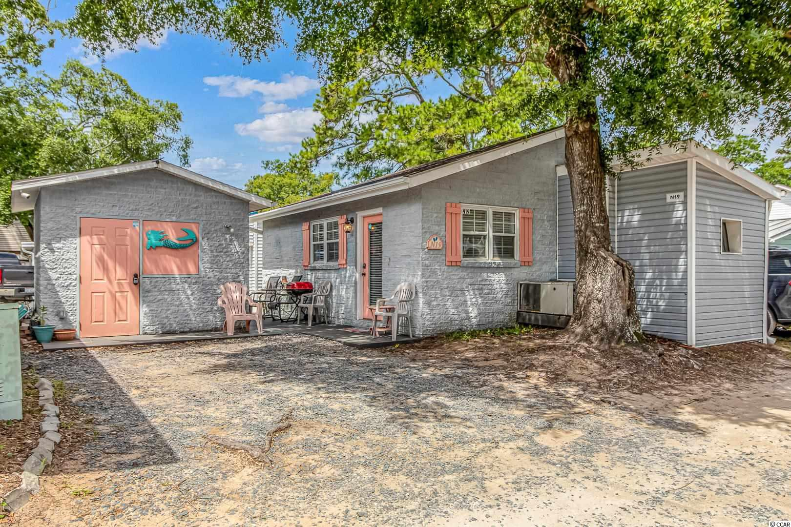 Do you want to live on VACATION full time or have a fabulous rental investment. This beach cottage is in the award winning Ocean Lakes, and is just a short stroll or golf cart ride to THE BEACH, the private water park, camp store, snack bar, and all the other amenities that Ocean Lakes has to offer. This beach hide away features 2 bedroom and 1 bath, large living room. It also includes ample parking for your golf cart and cars. MAKE YOUR DREAM OF LIVING AT THE BEACH COME TRUE!!!!!