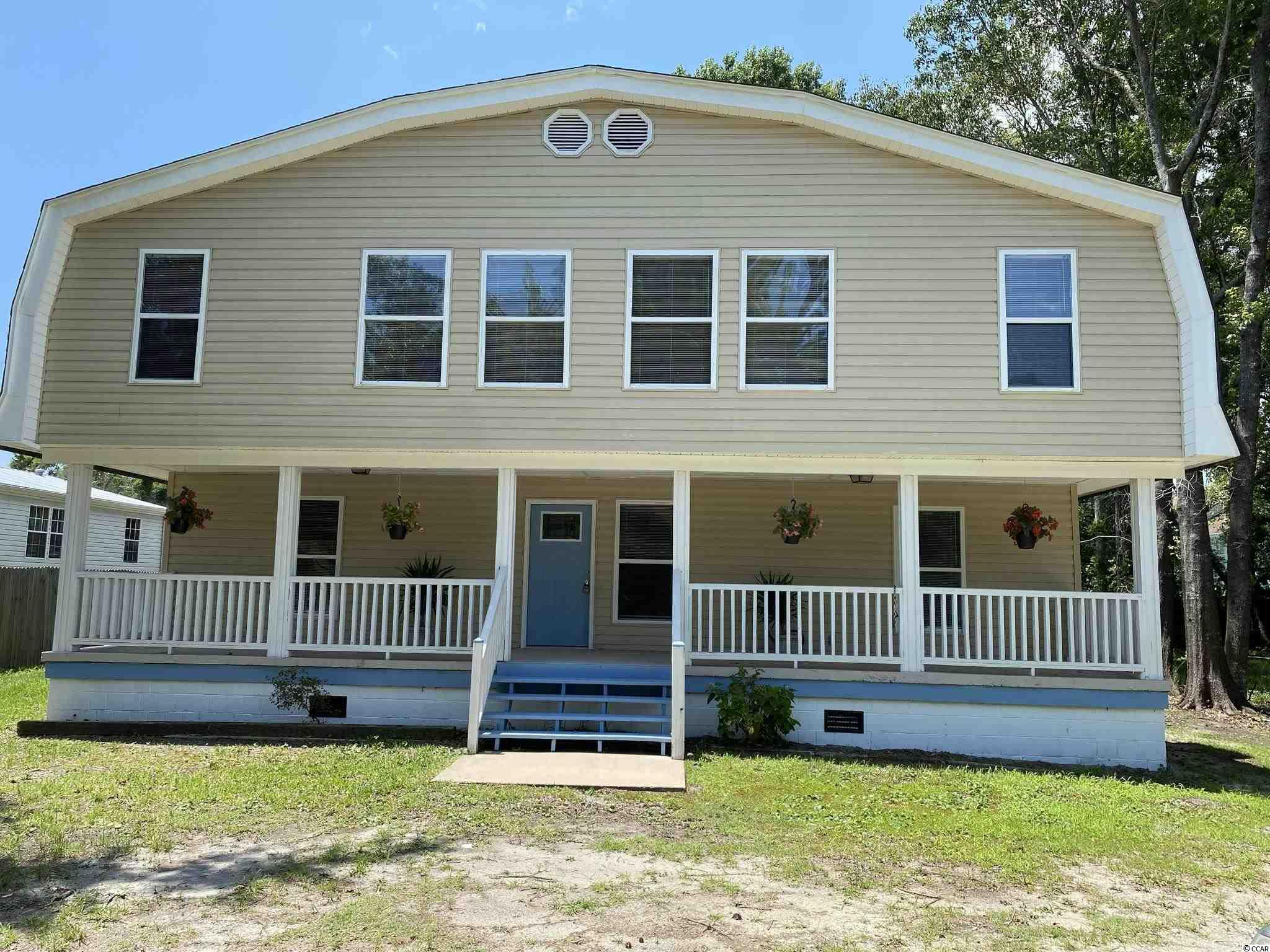 East of Hwy 17 in Garden City Beach.  Home was used to house Exchange students through an international program.  Zoning allows for residential or duplex.  3/4 of a mile to the beach.  First floor provides living room, four bedrooms, two full baths and a full kitchen.  Upstairs left side is comprised of three bedrooms, den/kitchen, full bath.   Upstairs right side is comprised of four bedrooms kitchen/den a one full bath.  There is no homeowners association this property is located in the unincorporated area of Garden City Beach.  The lot is huge with front and rear decks.   Very private backyard.